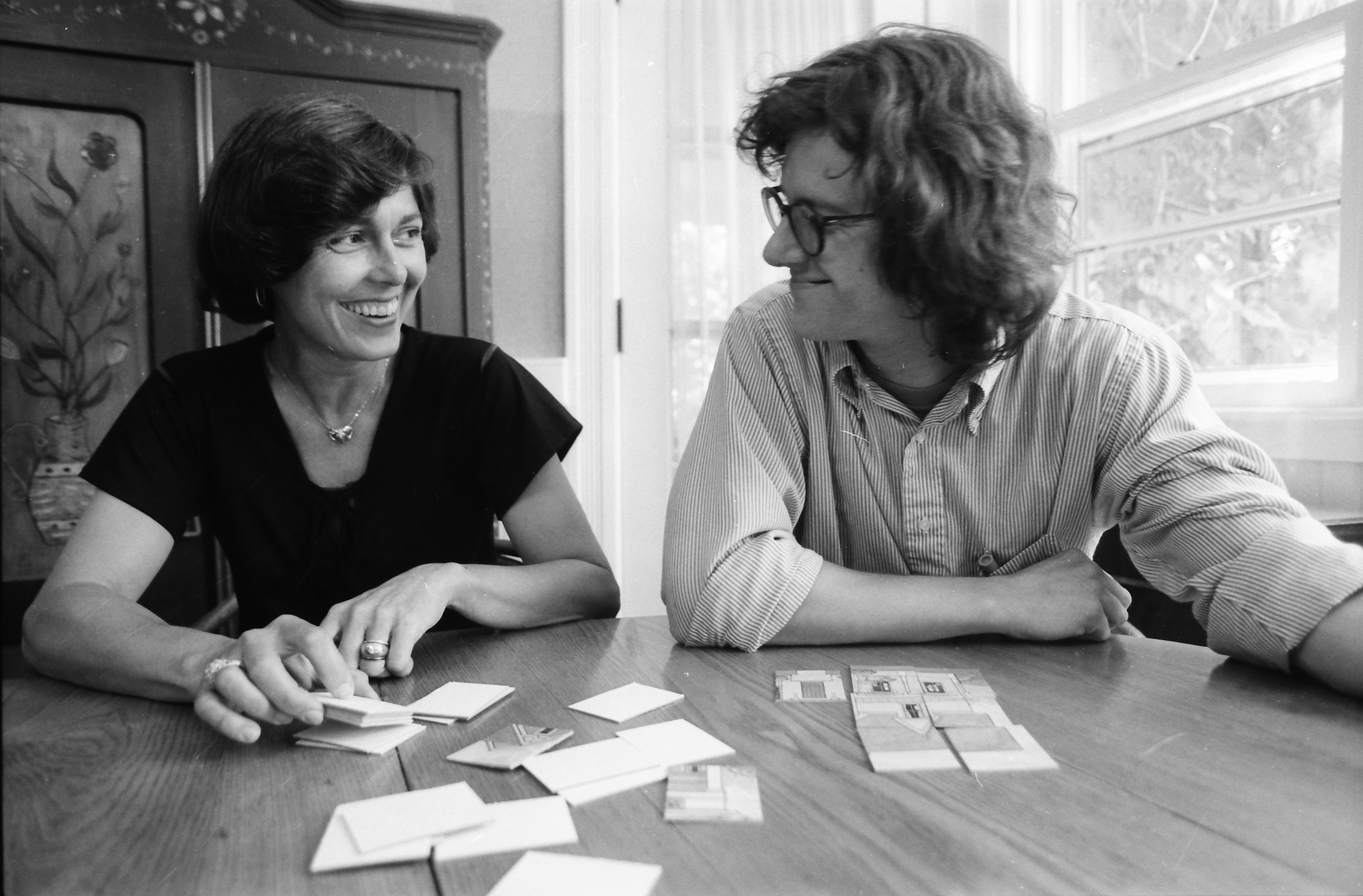 Jan Newman and Doug Kassabaum pose with new game 'Good Old Houses,' July 1981 image