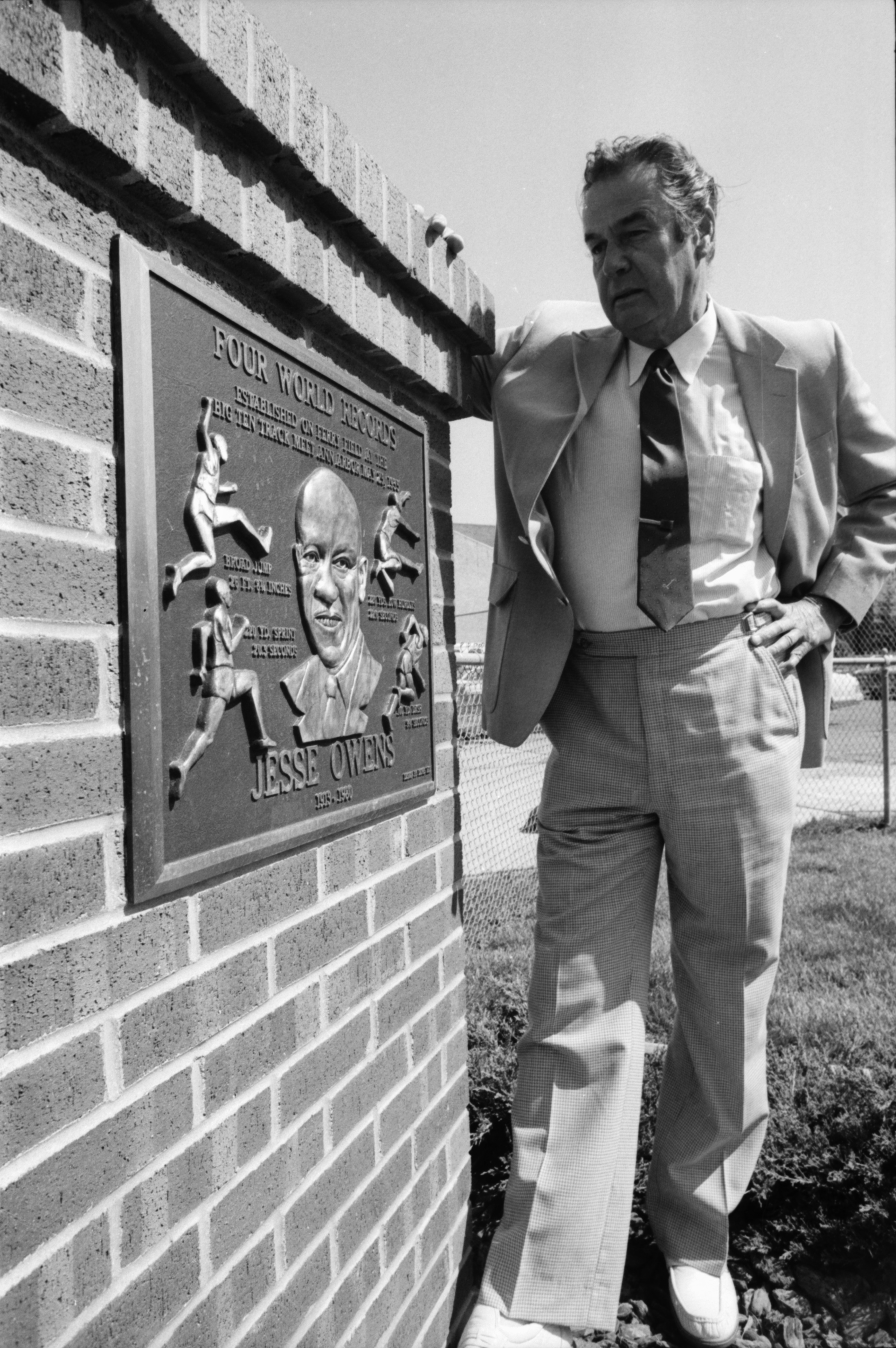 U-M Athletic Director Don Canham by plaque honoring Jesse Owens, May 1985 image