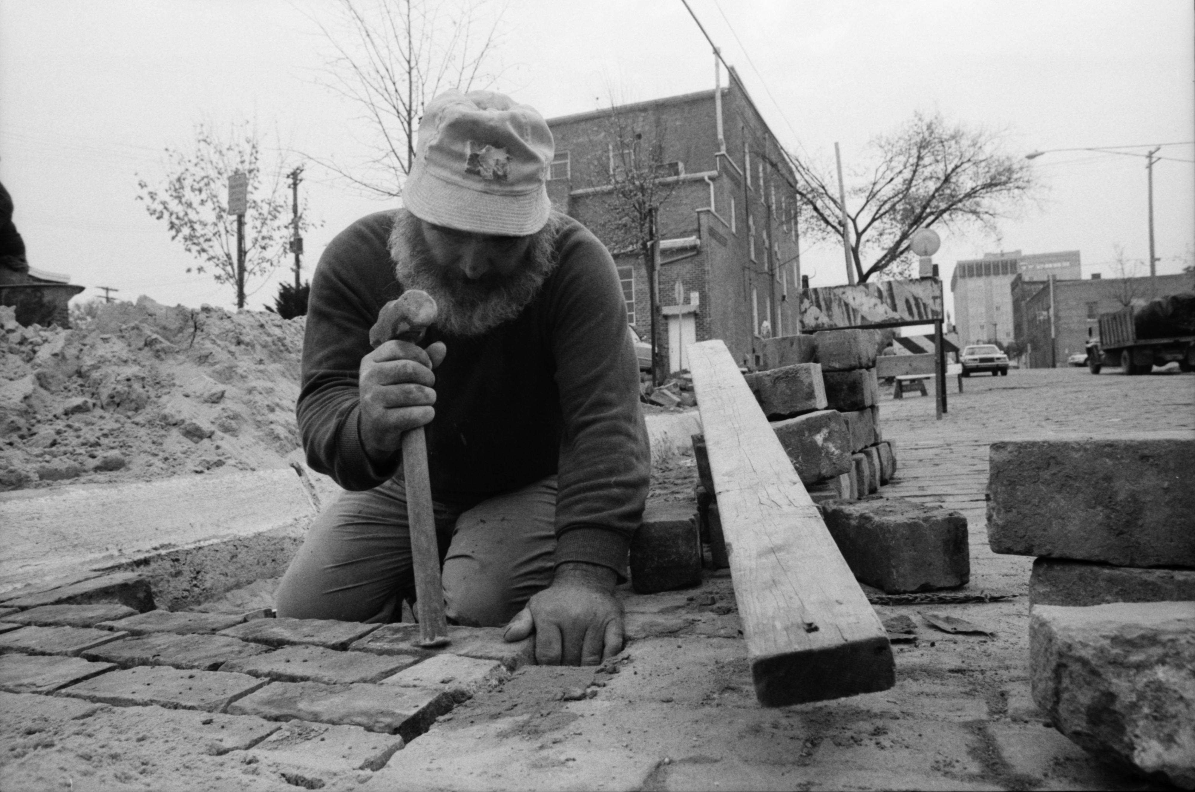 Roger Smith Repairs Bricks on Detroit Street, October 1984 image