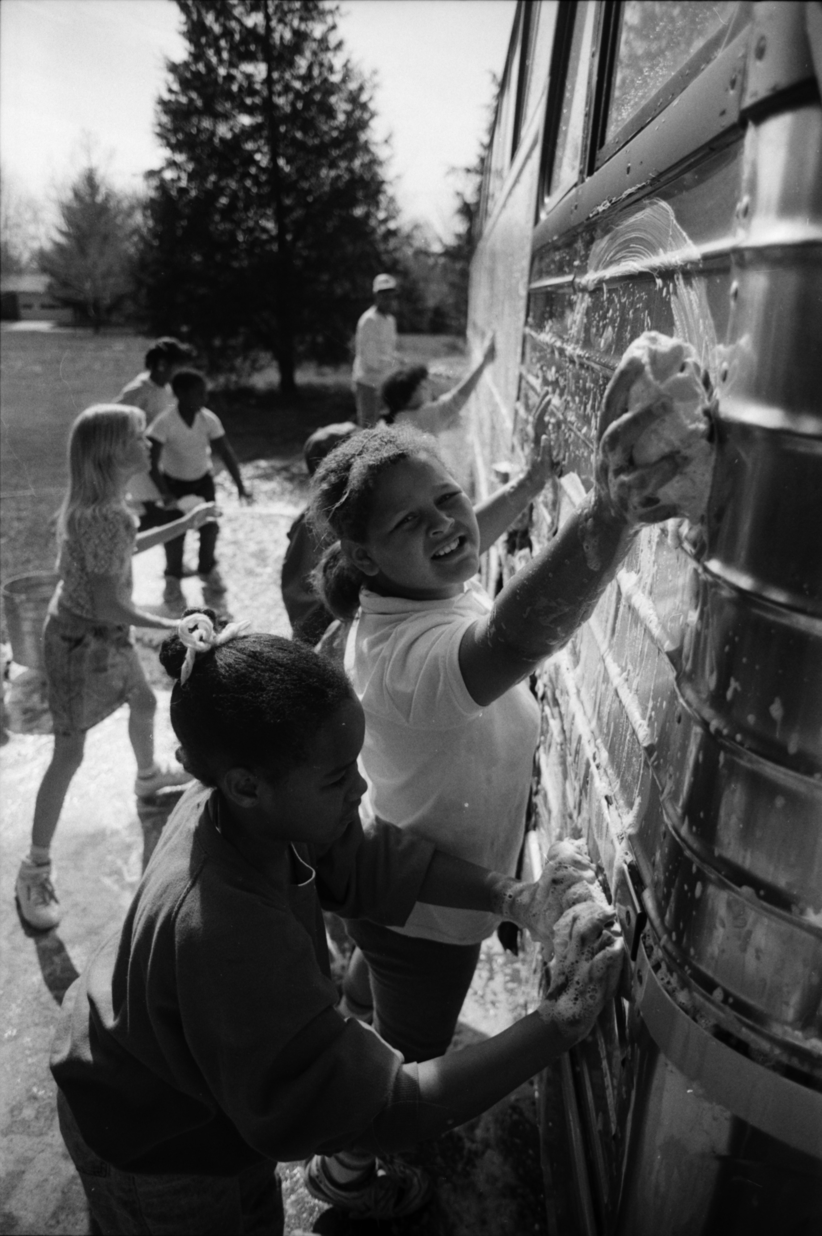 Peace Neighborhood Center Bus Wash Raises Money for Summer Camp, May 1988 image