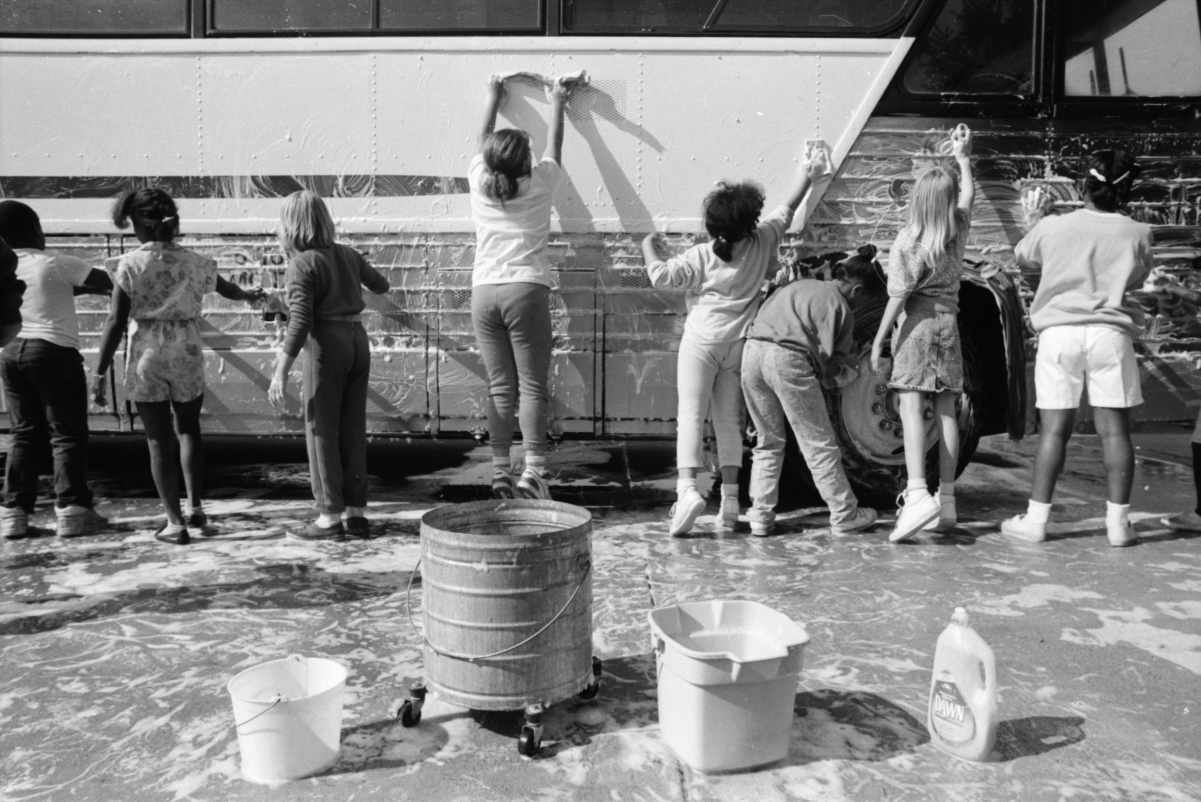 Children Scrub Bus to Raise Money for Peace Neighborhood Center Summer Camp, May 1988 image