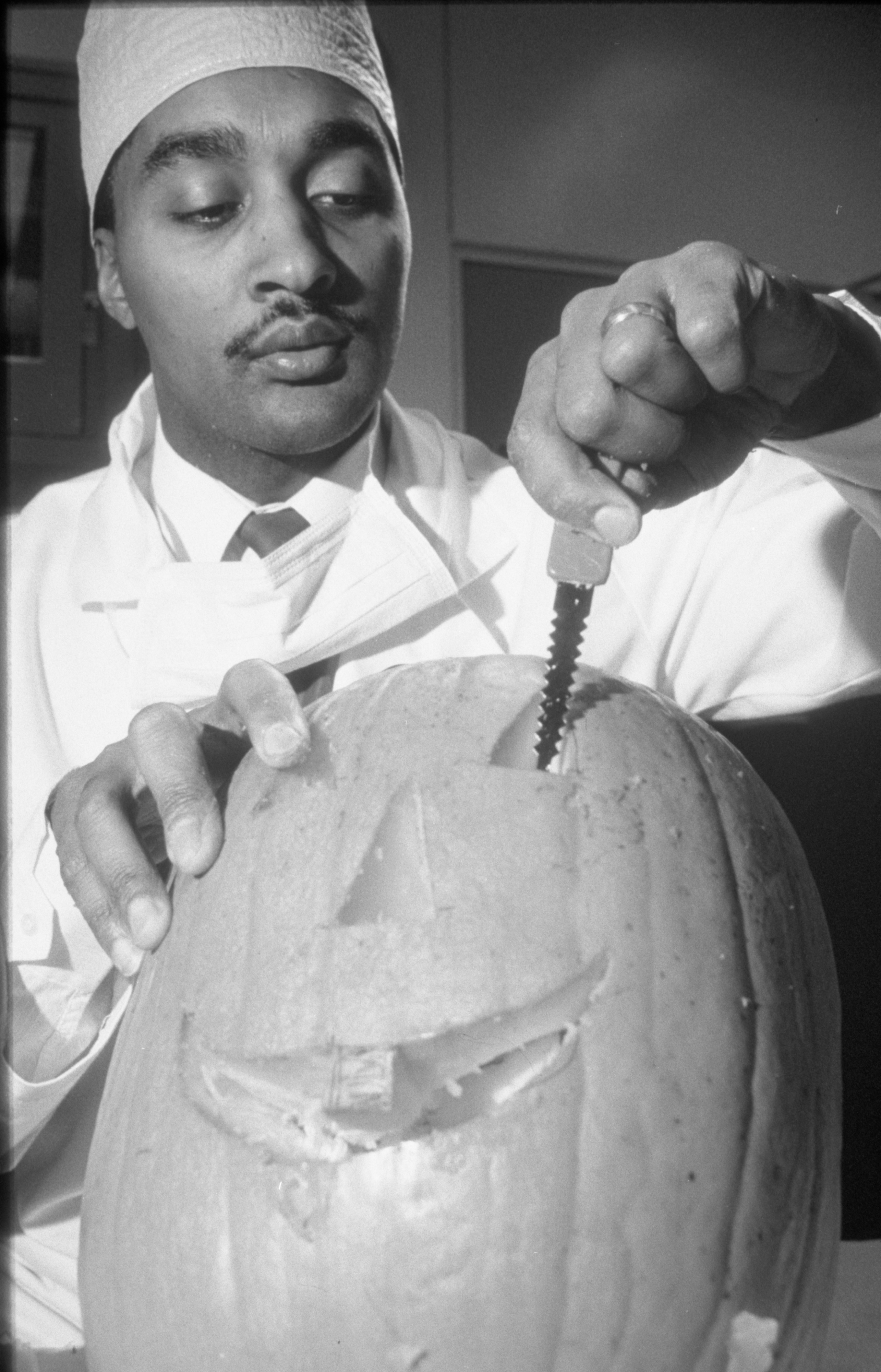 Dr. Ted Coleman Demonstrates Pumpkin Carving With A Serrated Knife, October 1988 image