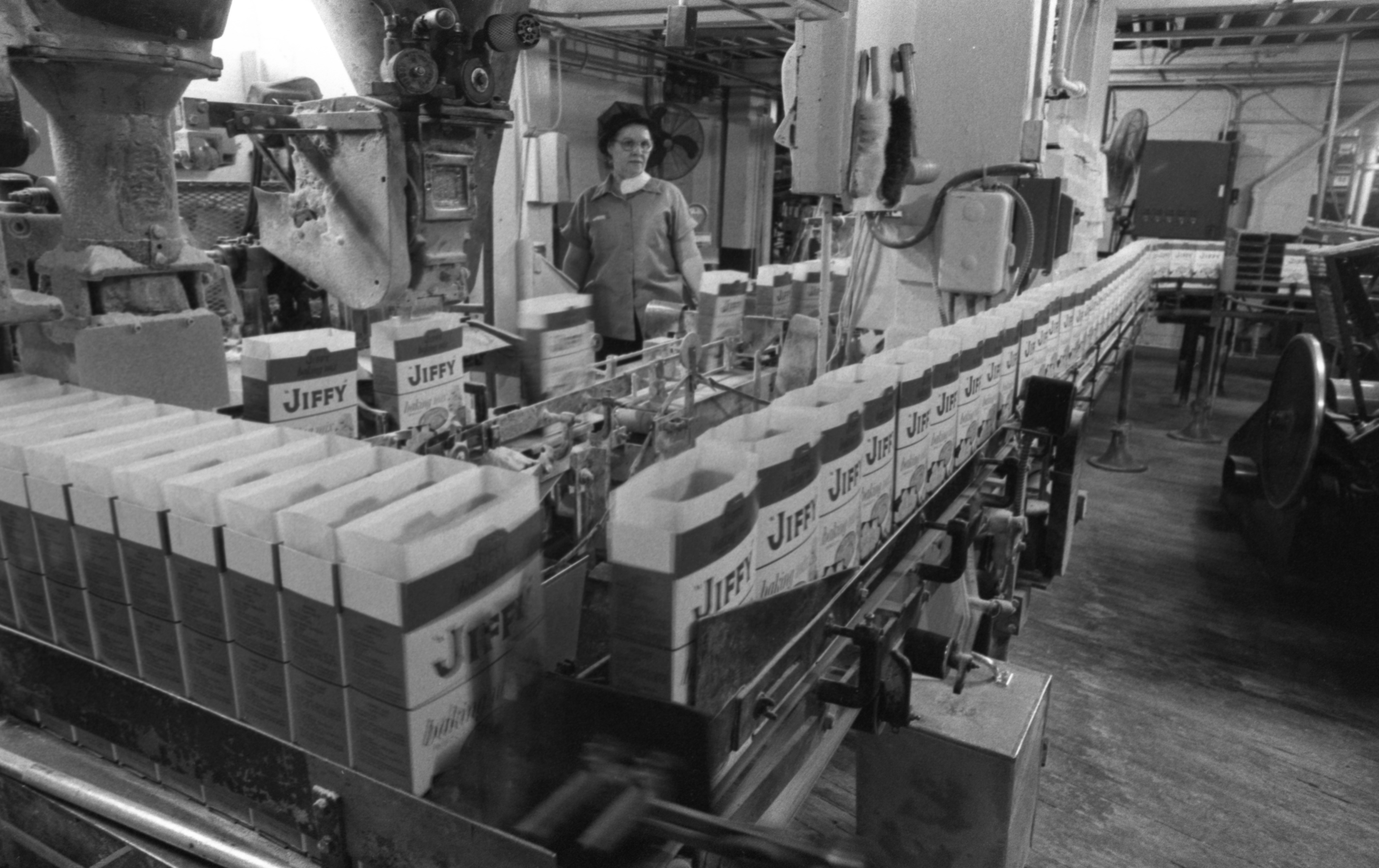 Boxes Line Up To Be Filled In The Jiffy Mix Packaging Plant, January 1989 image