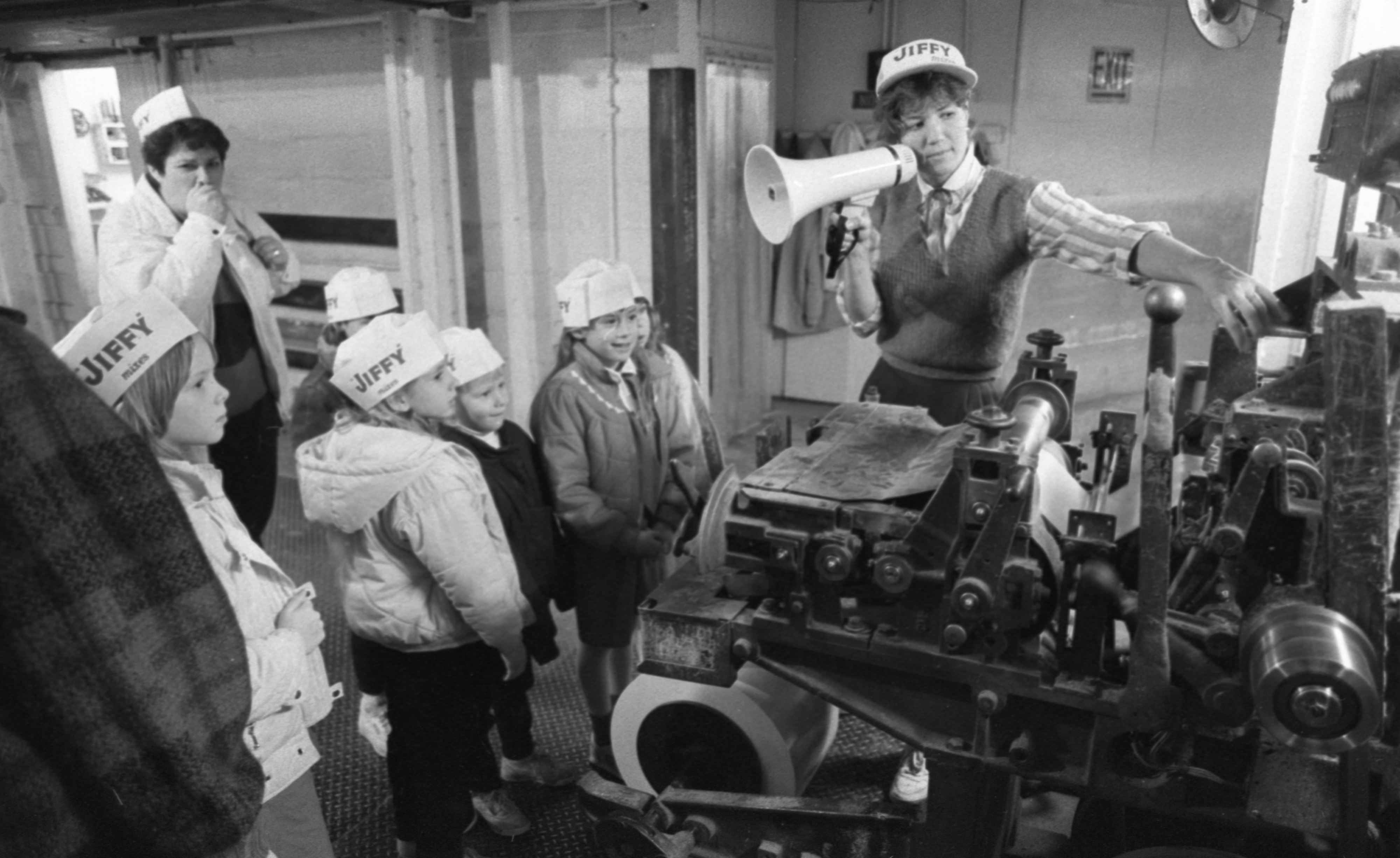 Lynne Farley Shows A Brownie Troop How Boxes Are Made In The Jiffy Mix Packaging Plant, January 1989 image