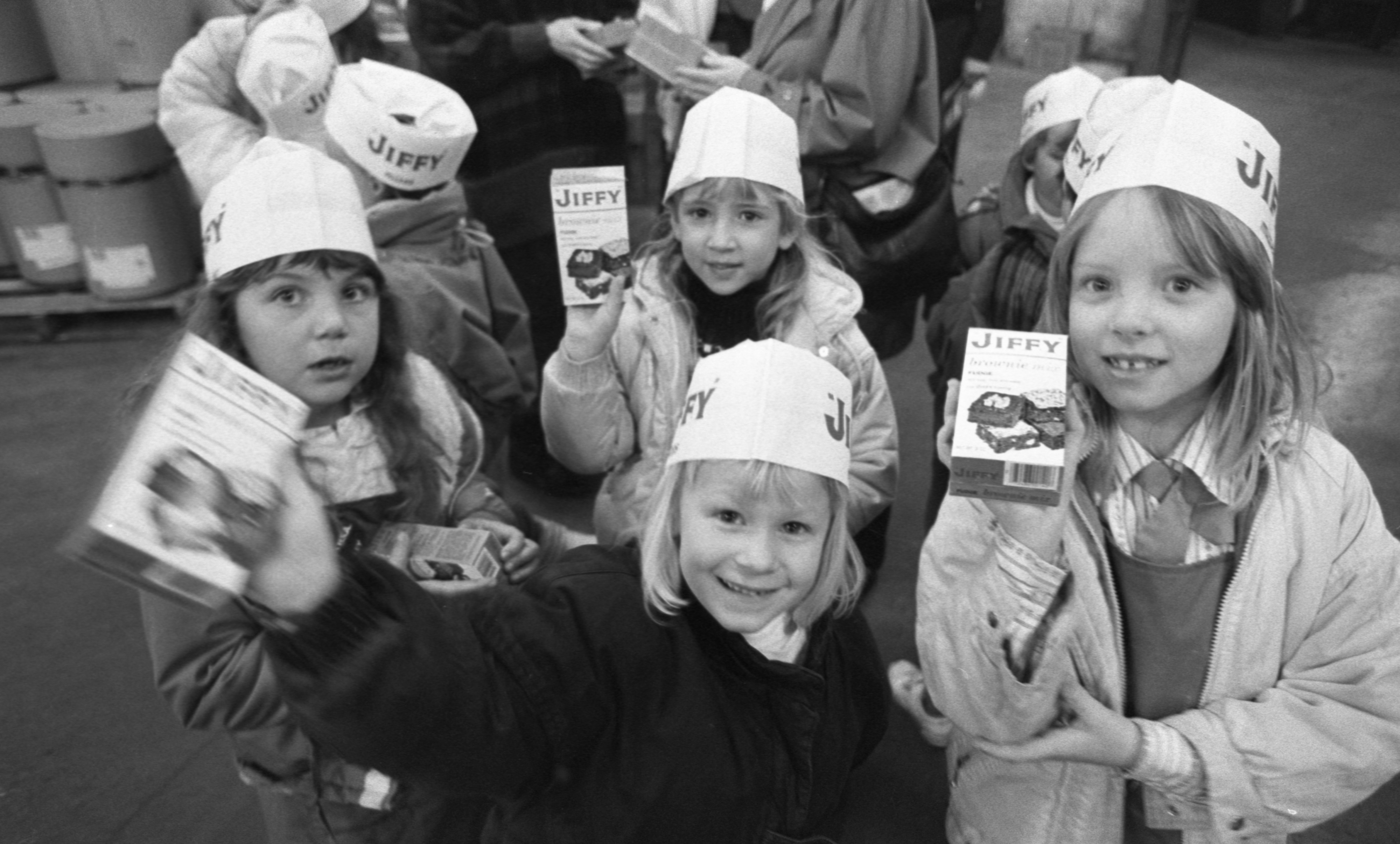 Members Of Haisley Elementary Brownie Troop Receive Free Boxes Of Jiffy Mix On Their Tour, January 1989 image