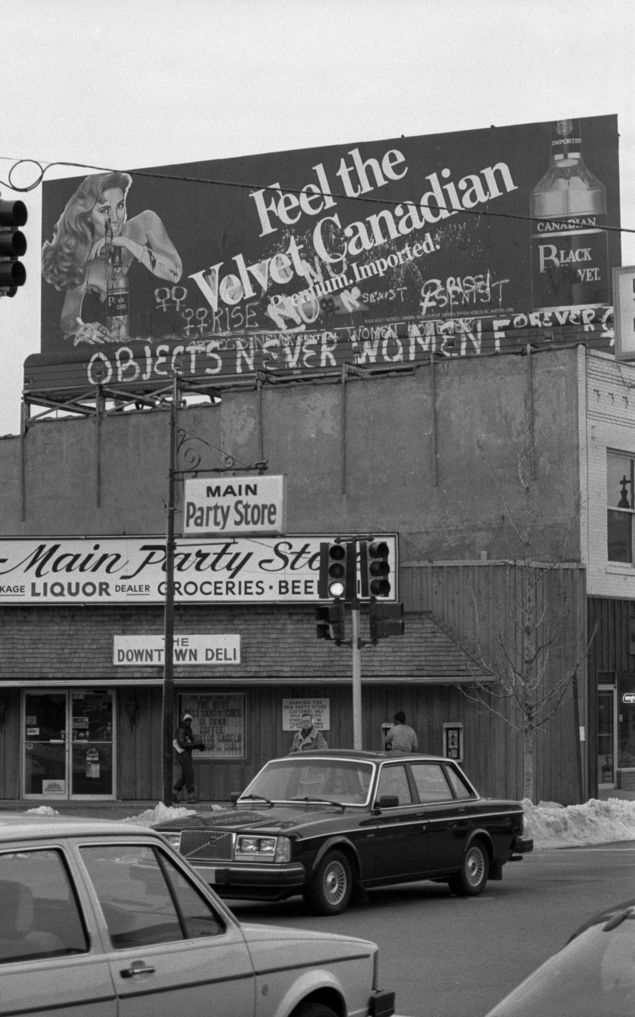 Defaced Billboard Atop Main Party Store, March 1985 image