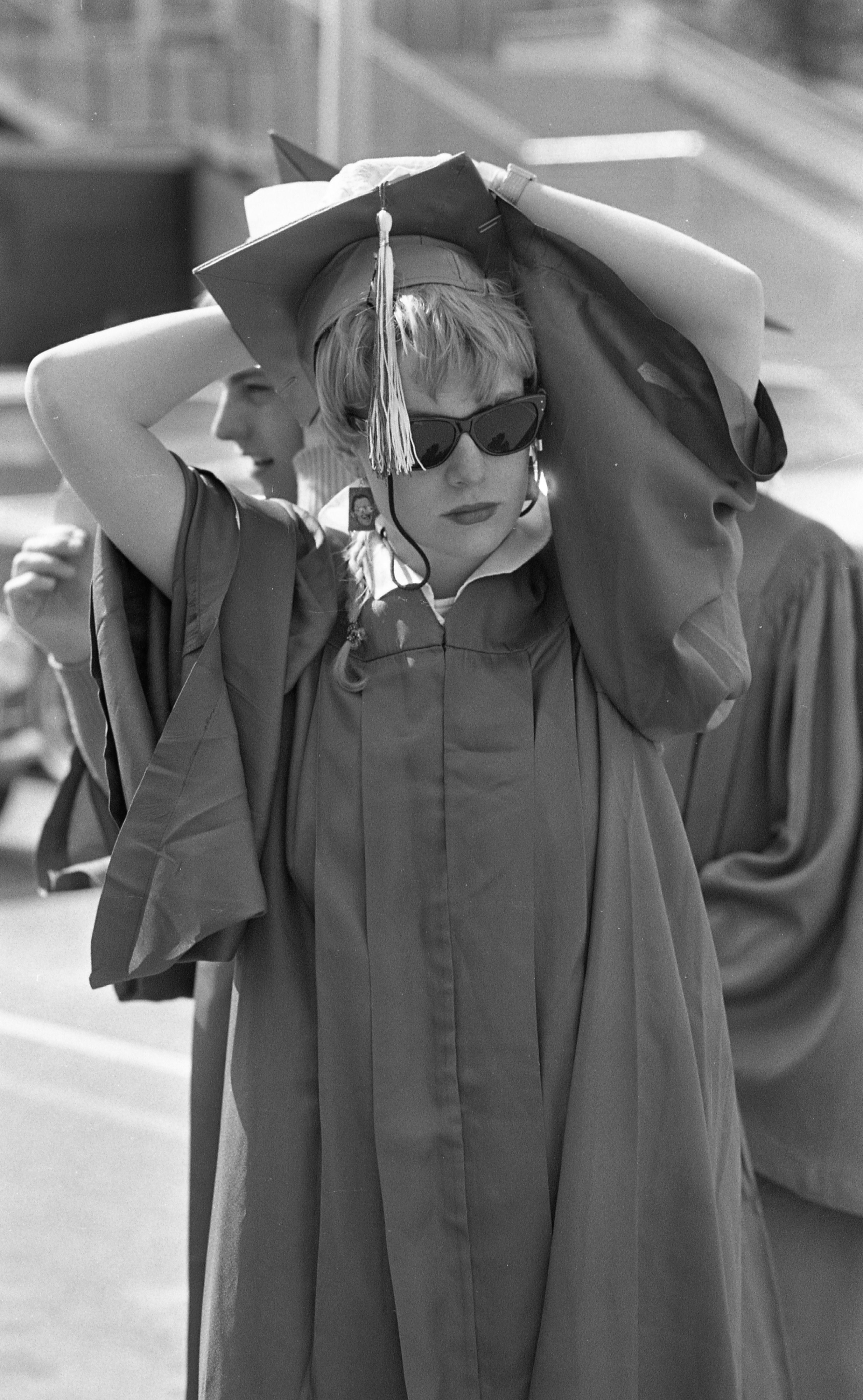 Pioneer Student Kris Schrader Adjusts Her Cap Before Graduation, June 1985 image