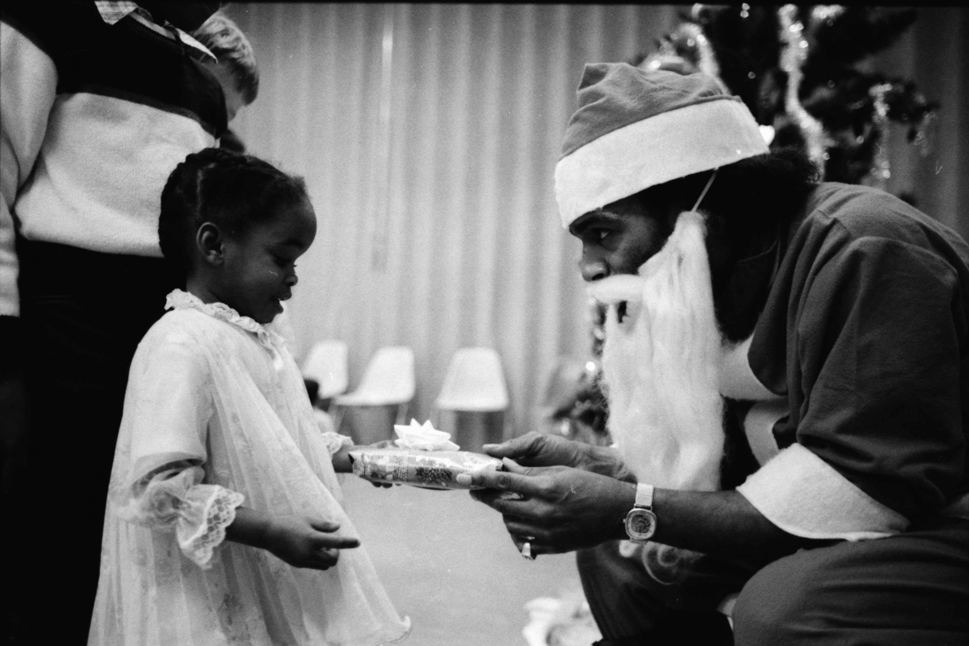 Josephine Smith gets a gift at the Ann Arbor Community Center, December 1982 image