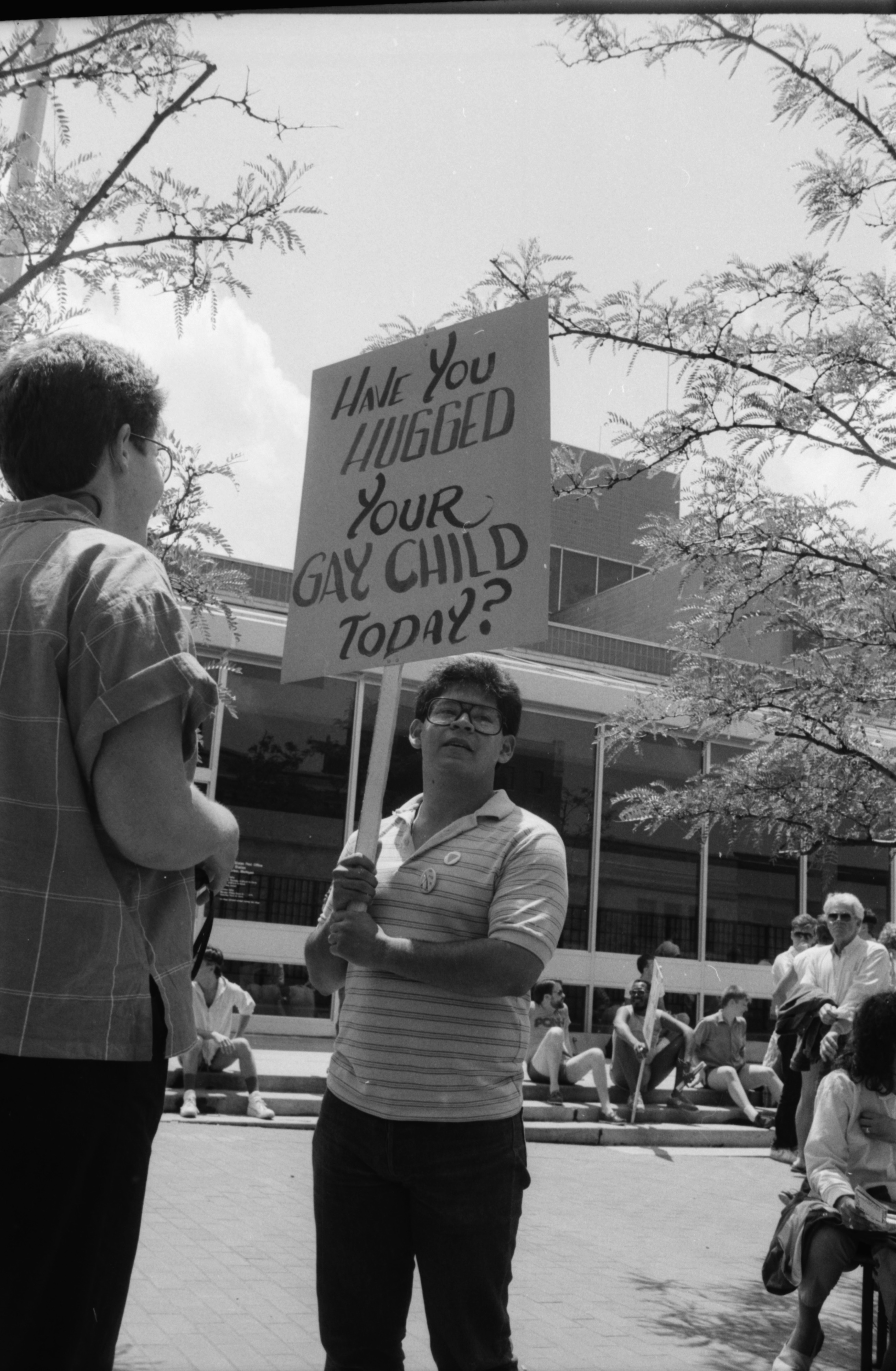 Gay Rights Activist Holds Sign Outside Federal Building, June 1985 image