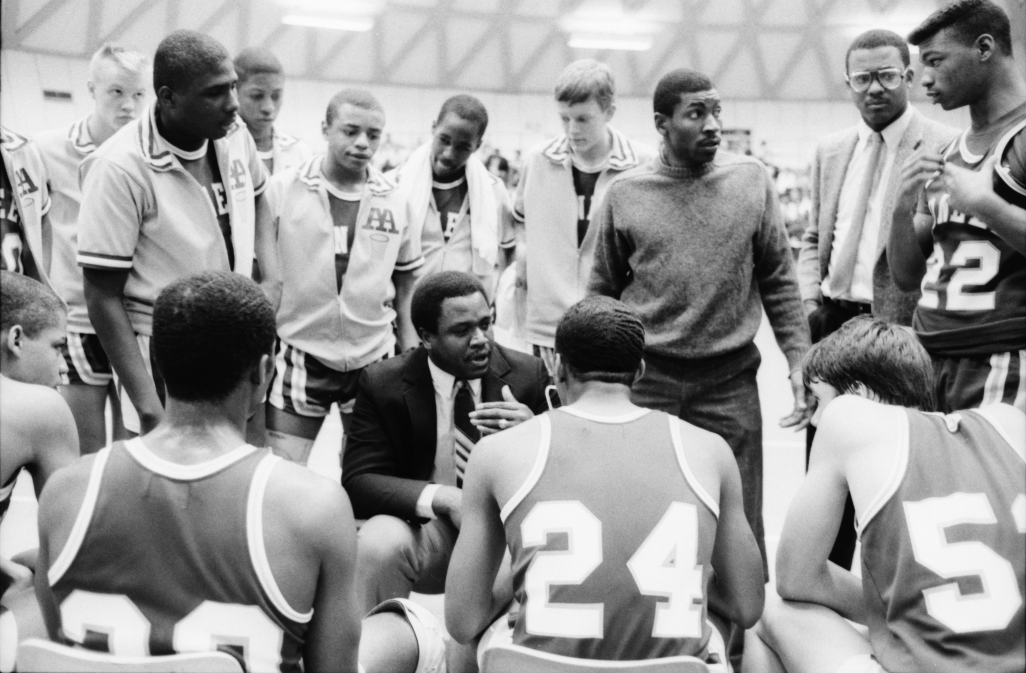 Pioneer Basketball Team Listens to Coaches During Playoff Game Against Huron, March 1986 image