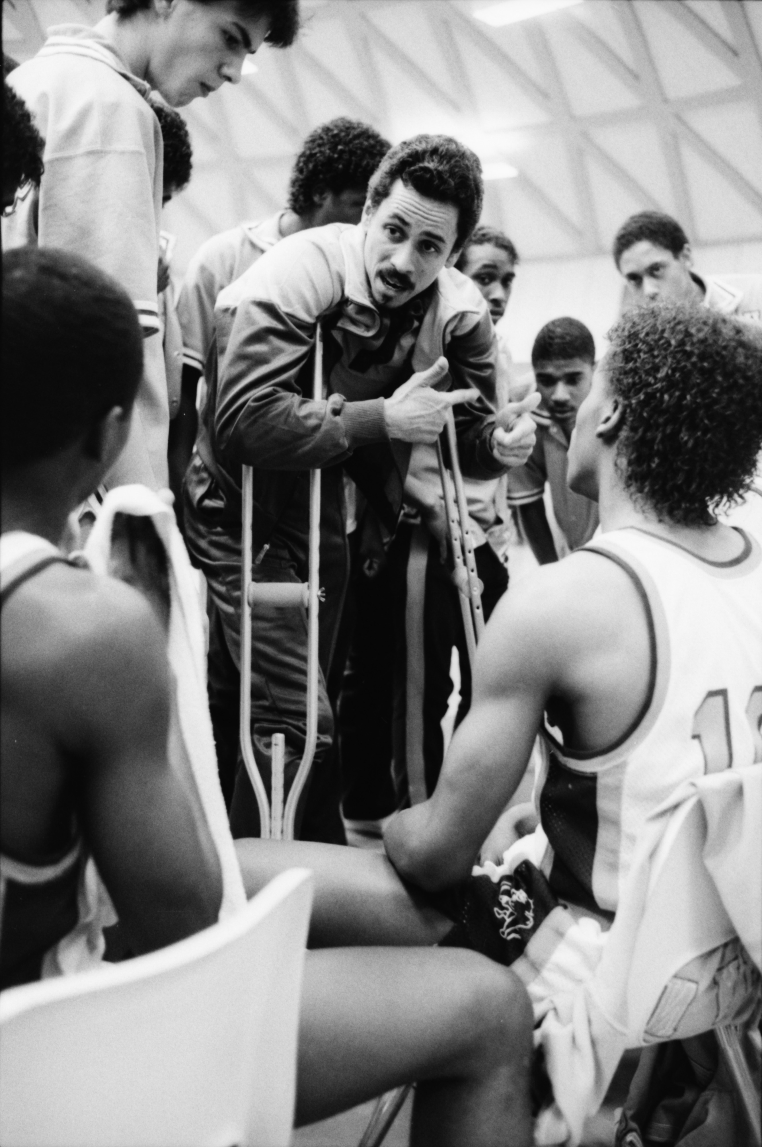 Huron Basketball Coach Harold Simons Gives Pep Talk During 54-53 Playoff Win Against Pioneer, March 1986 image