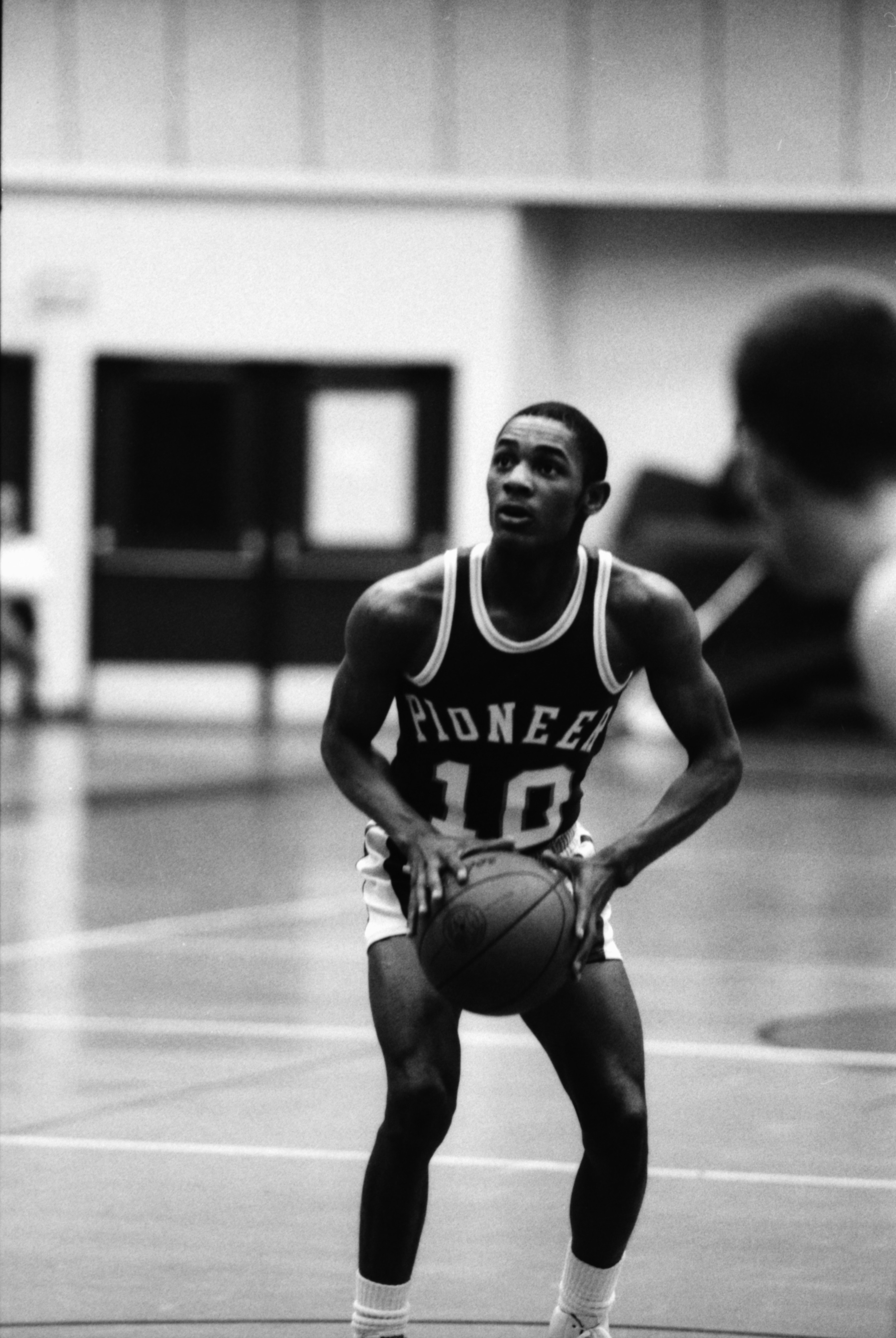 Huron Basketball Player Prepares to Shoot in Playoff Game Against Pioneer, March 1986 image