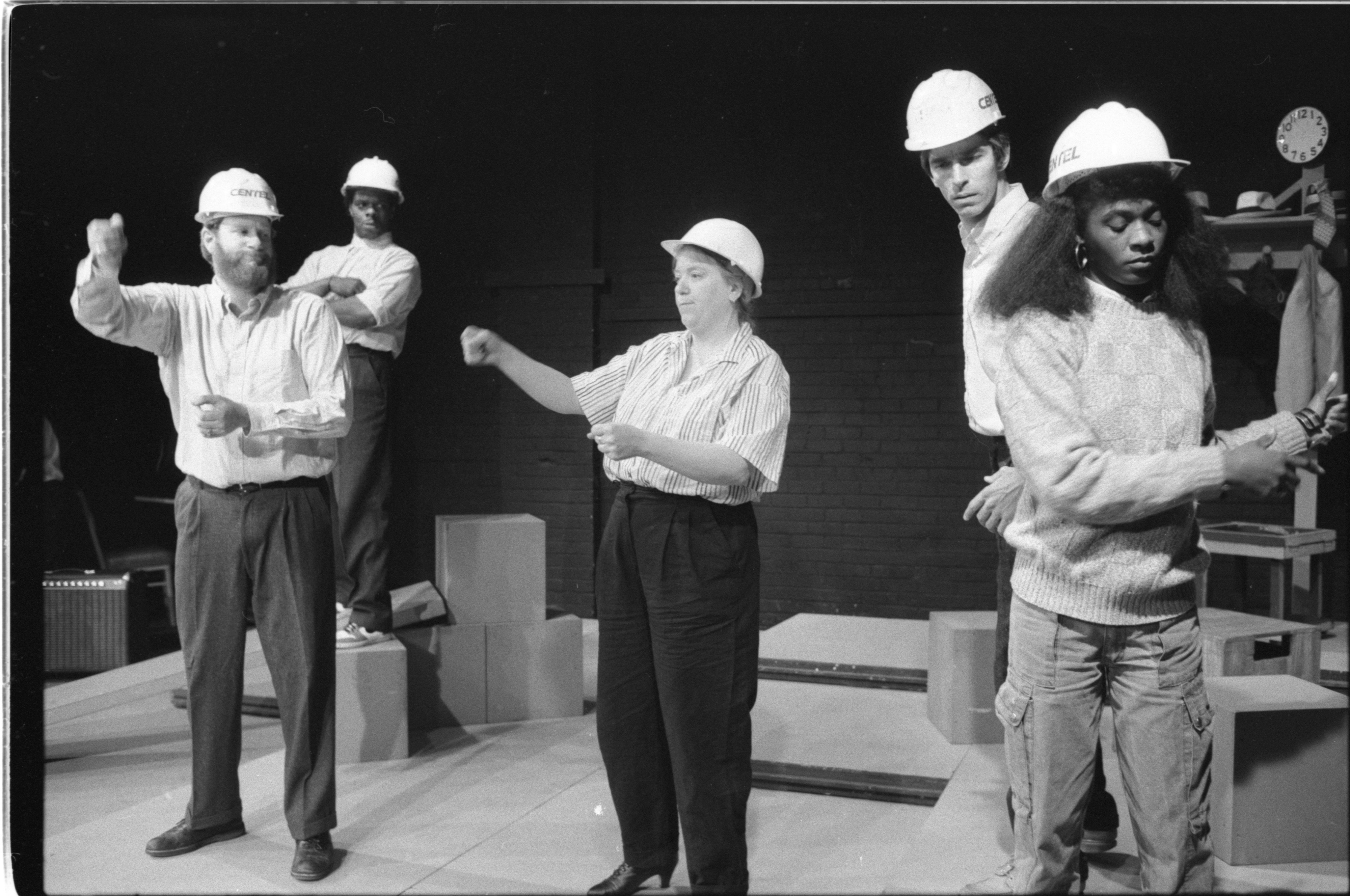 Actors mime a work day in 'Worksong,' October 1986 image