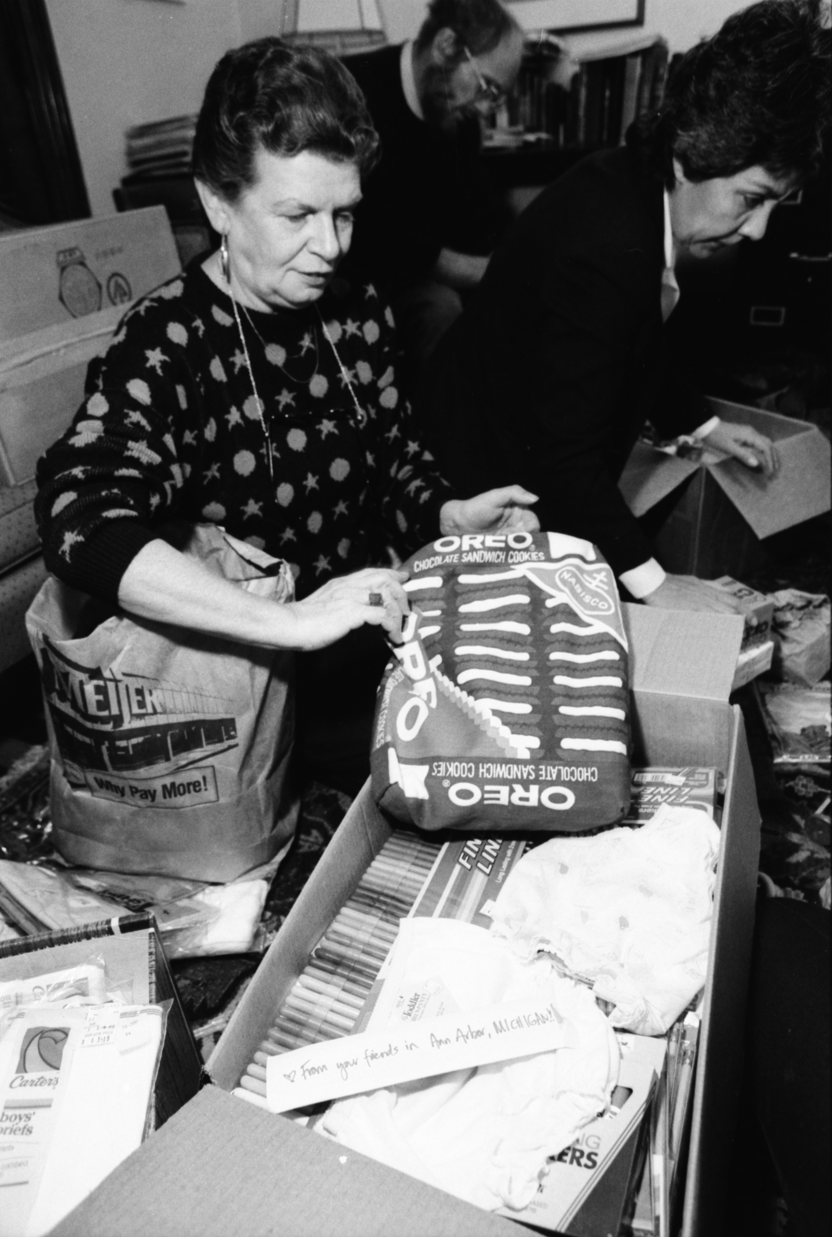 Mary Lee Pierce Wrapping Gifts for Nicaragua, October 1986 image