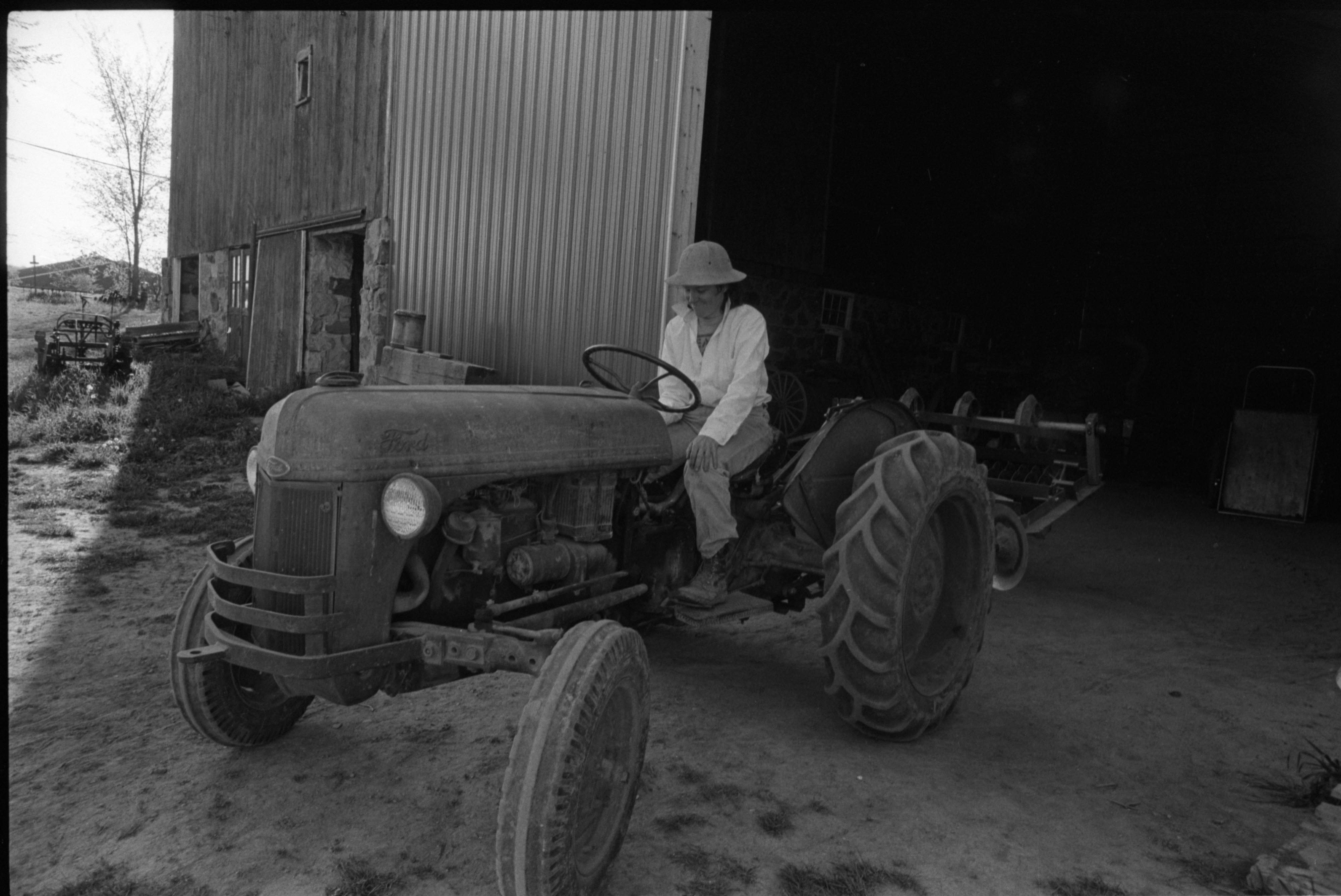 Marcia Barton Drives The Tractor At Community Farm, May 1988 image