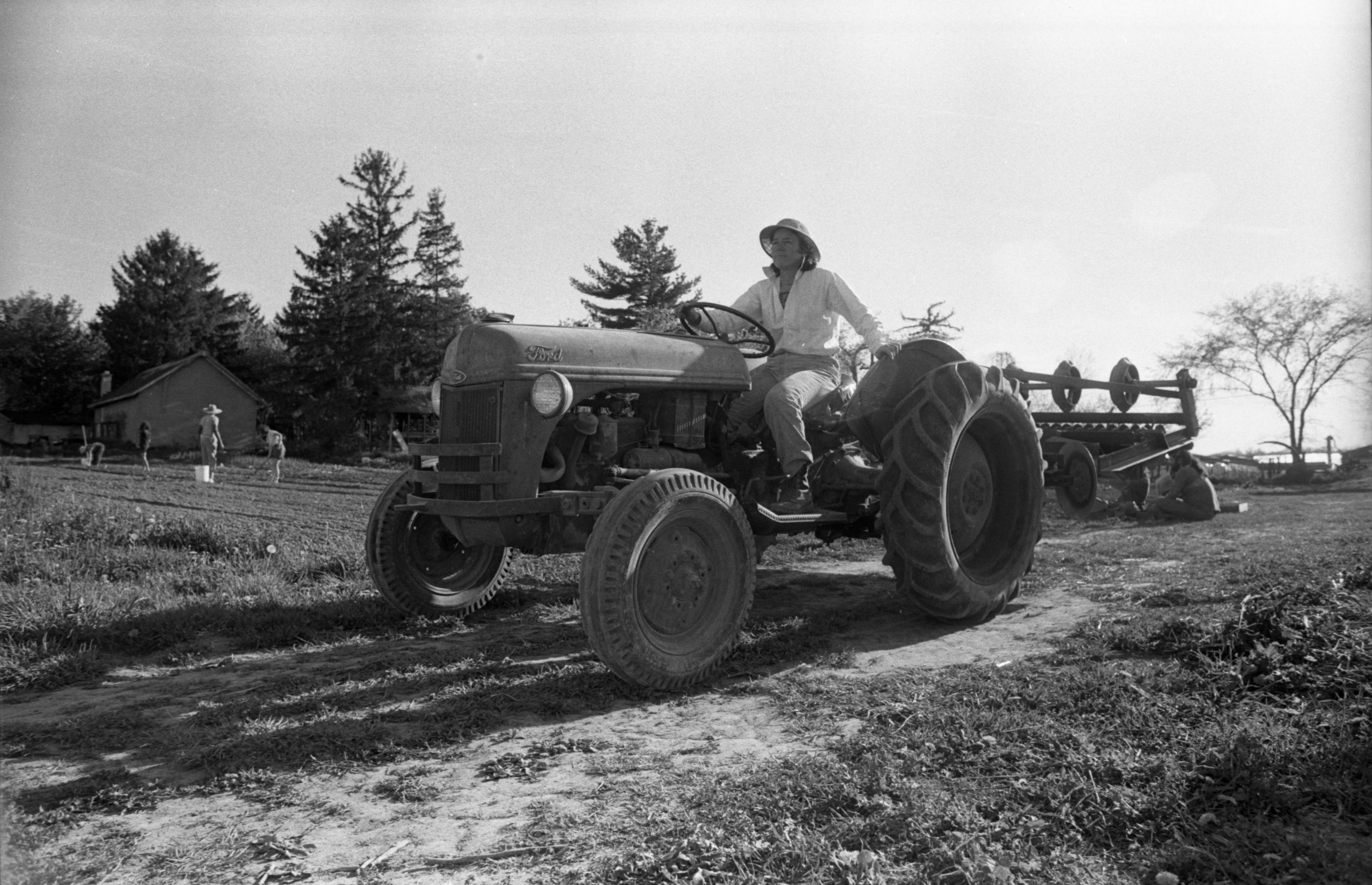 Marcia Barton Drives The Tractor At Community Farm, May 14, 1988 image