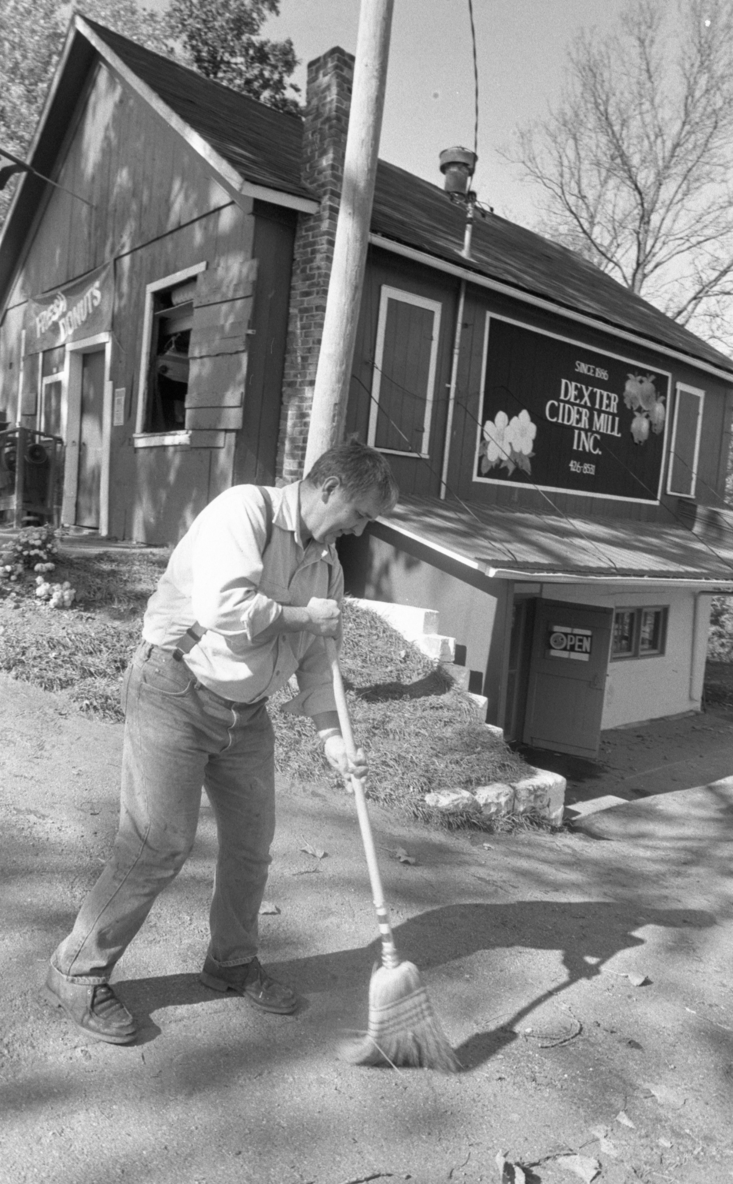 Richard Koziski, Owner, Sweeps In Front Of The Dexter Cider Mill, October 1988 image