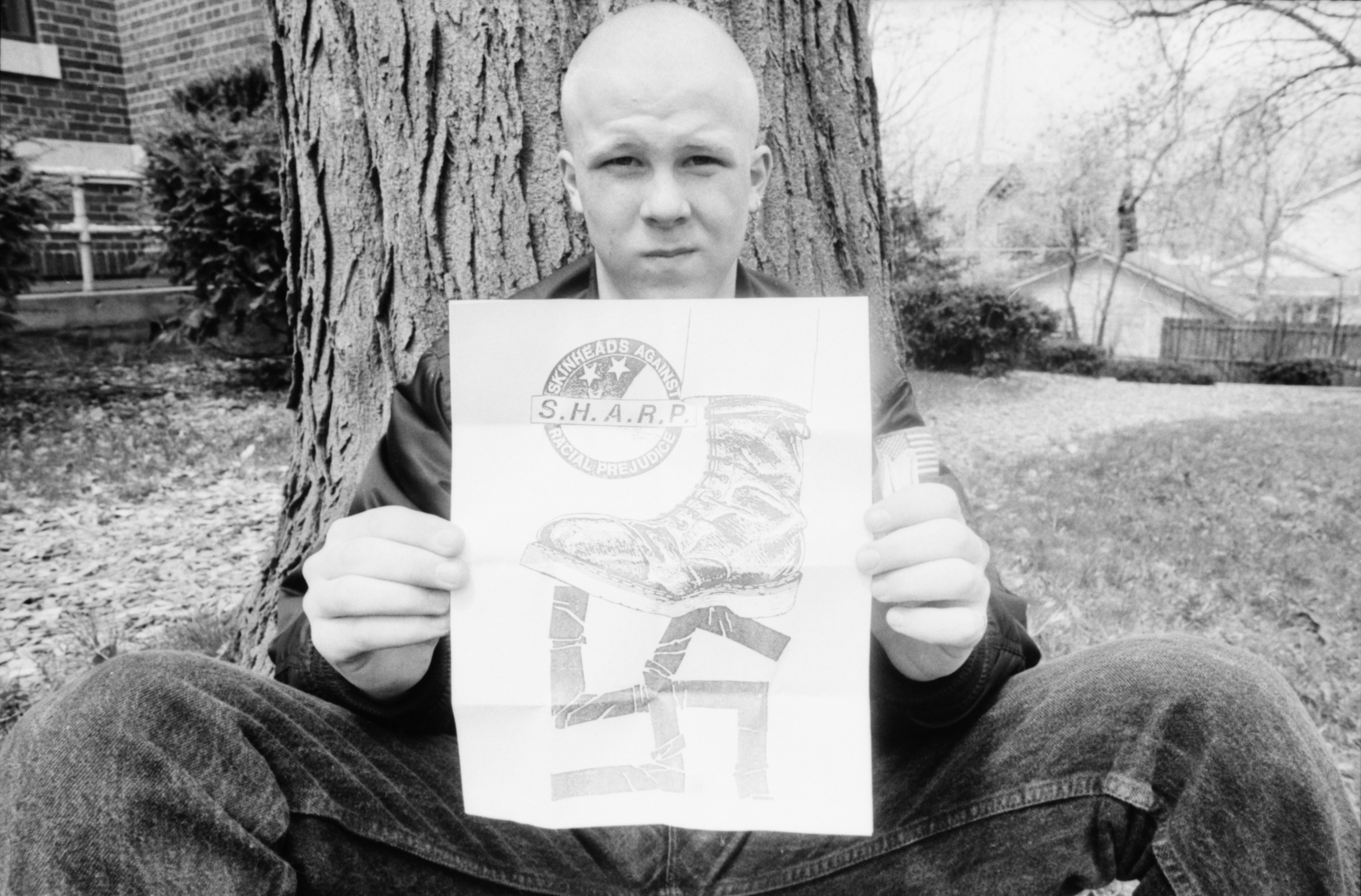 Community High Skinhead Dylan Goodman Holds Anti-Racism Poster, April 1989 image