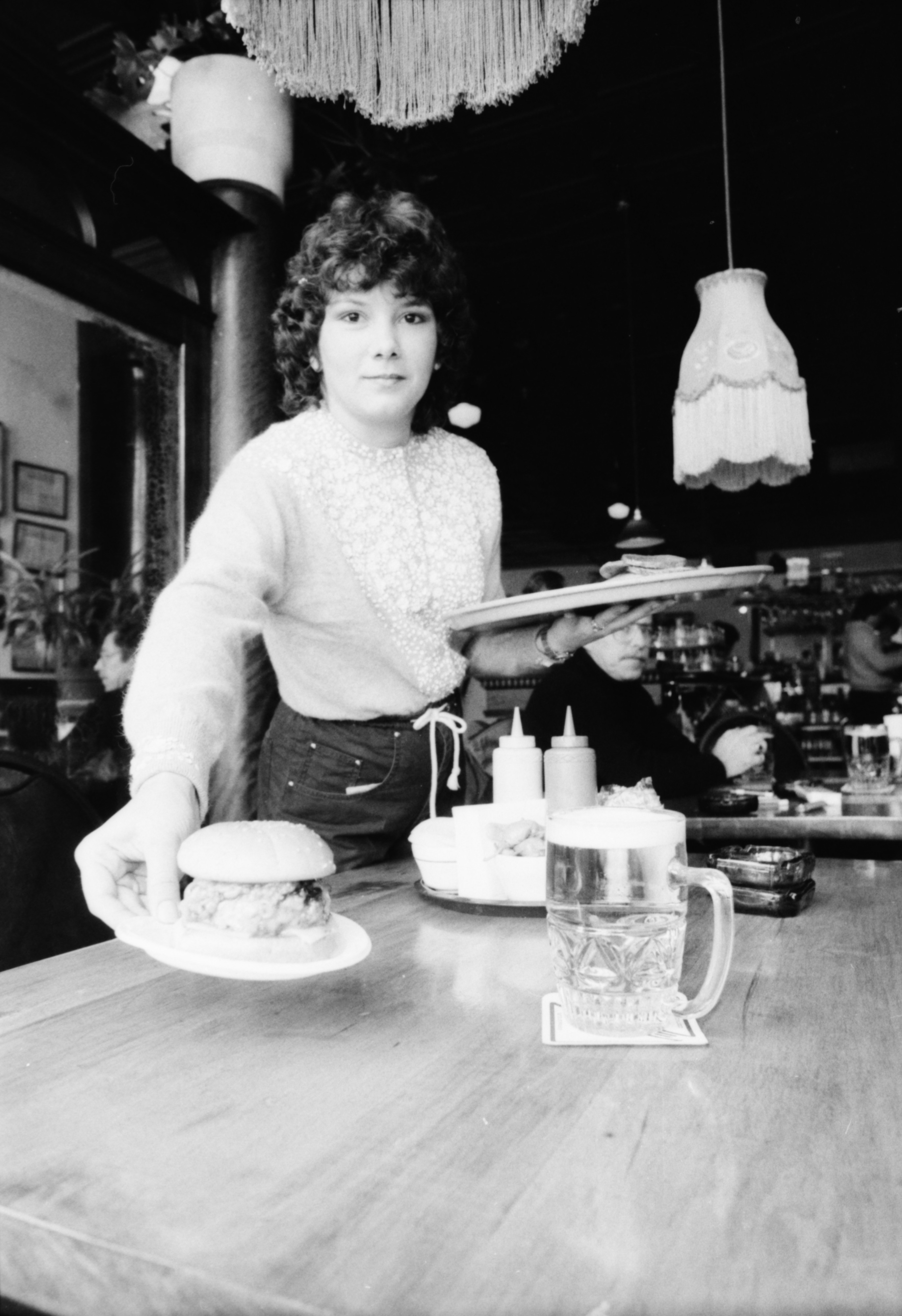 Waitress at Sidetrack Bar and Grill in Ypsilanti, February 1984 image