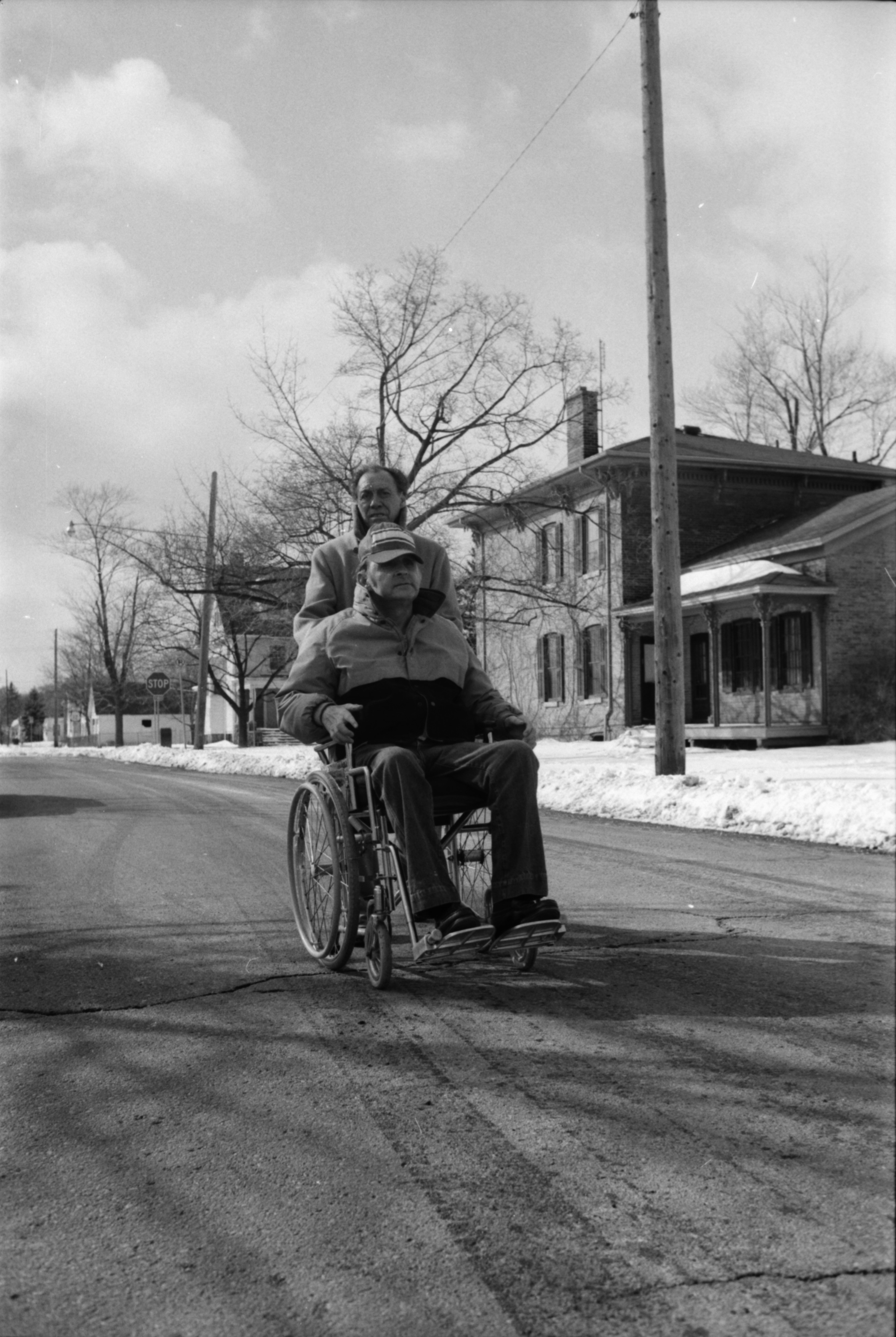 Man in Wheelchair Navigates Ypsilanti's Depot Town, February 1984 image