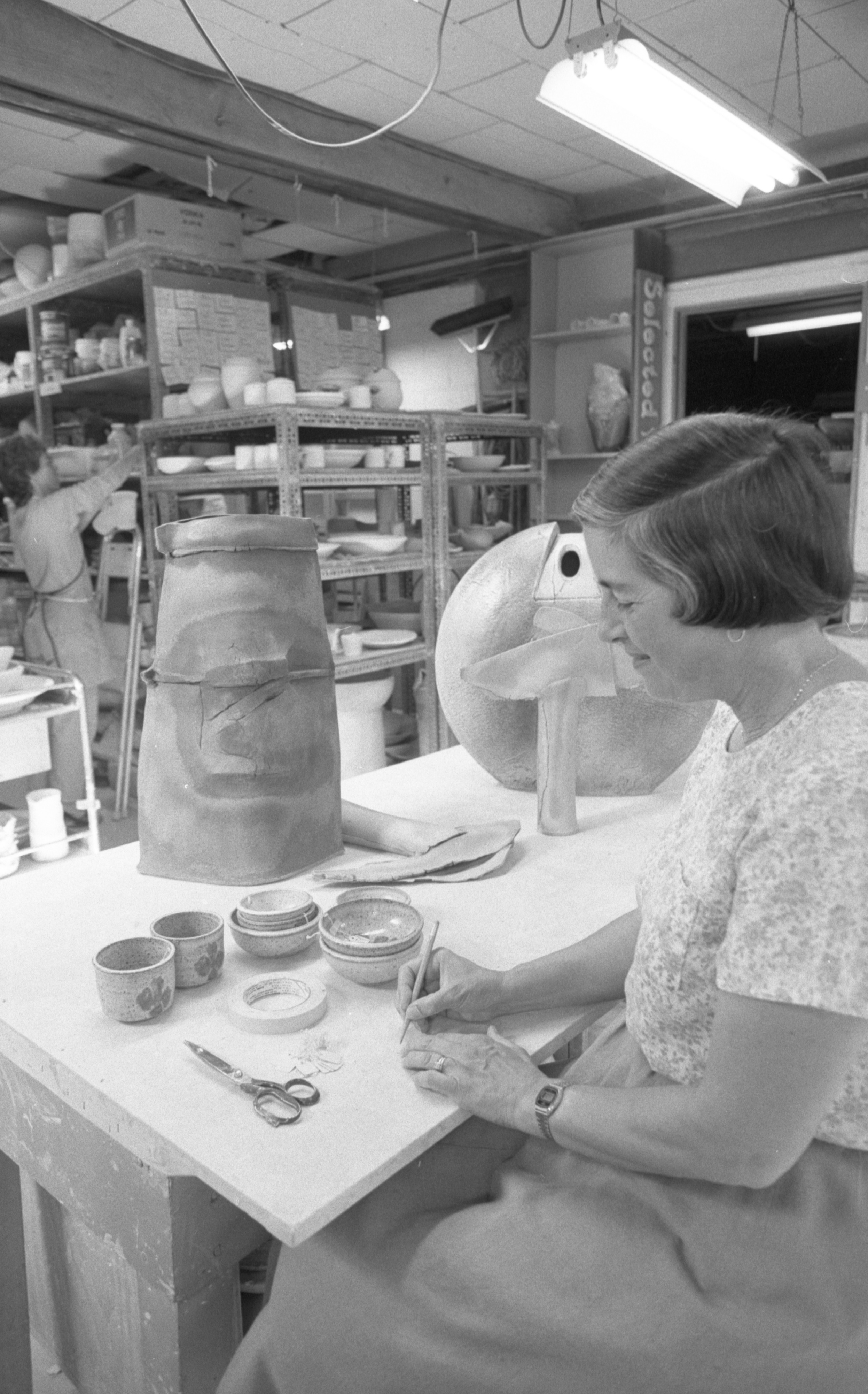 Ellie Shappirio Prepares Ceramics For The Potters Guild Annual June Sale, May 1985 image