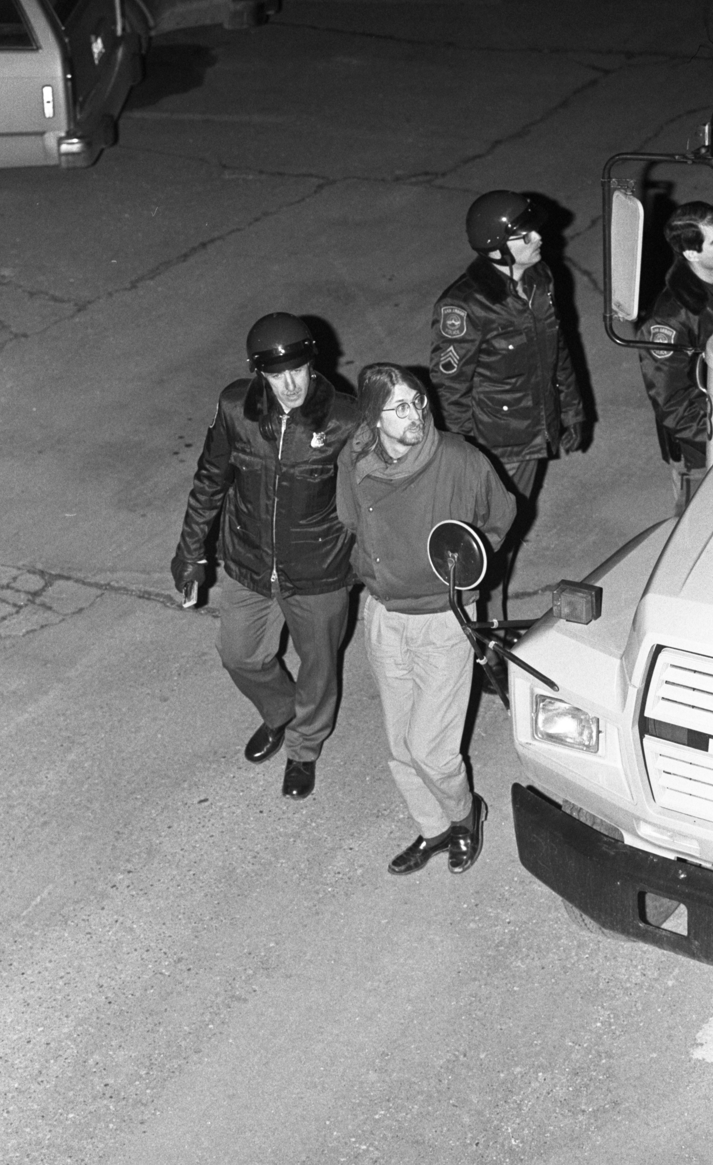 Ann Arbor Police Escort Arrested Protesters To City Hall, March 1986 image
