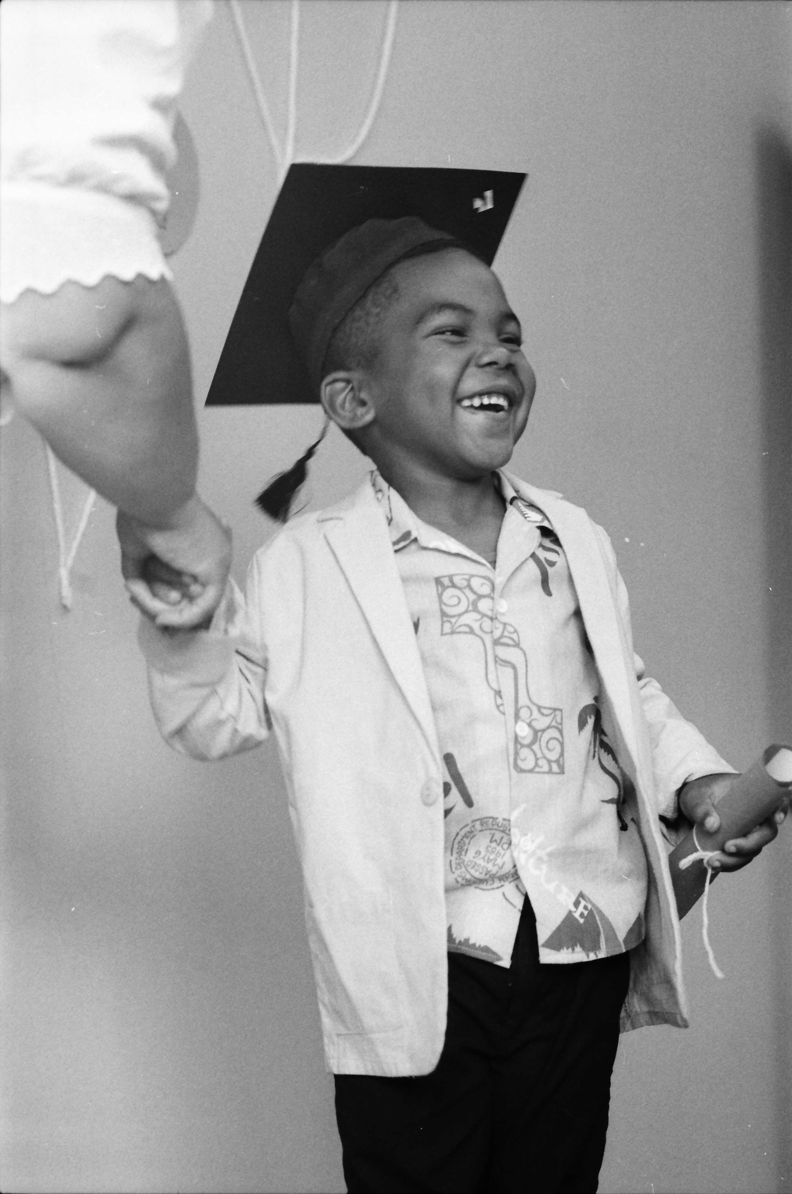 Jayson Atkins Receives Diploma at Ypsilanti Pre-School Graduation at Parkridge Community Center, May 1986 image