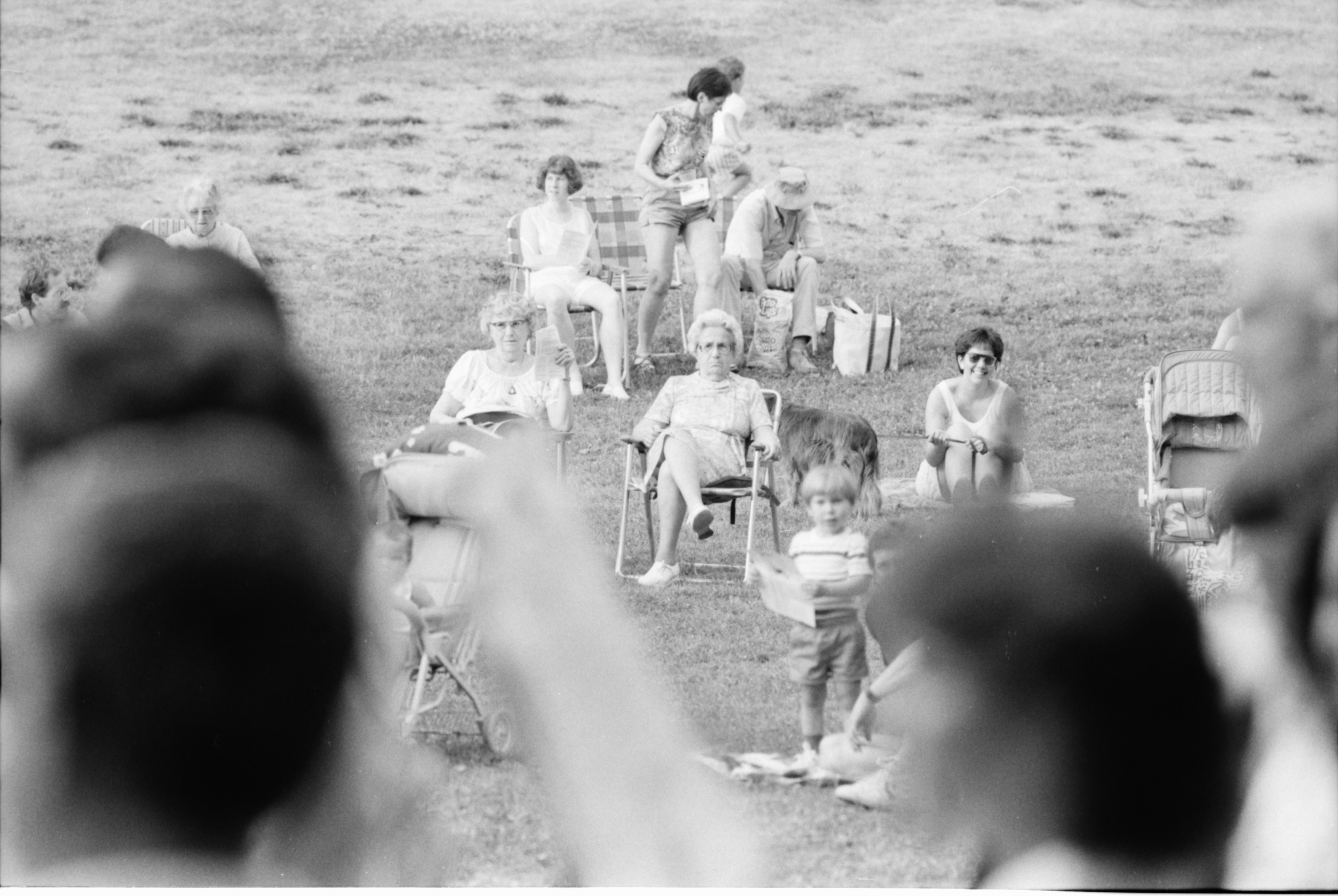 Attendees watch the Ann Arbor Civic Band plays at West Park in 90-degree heat, July, 1988 image