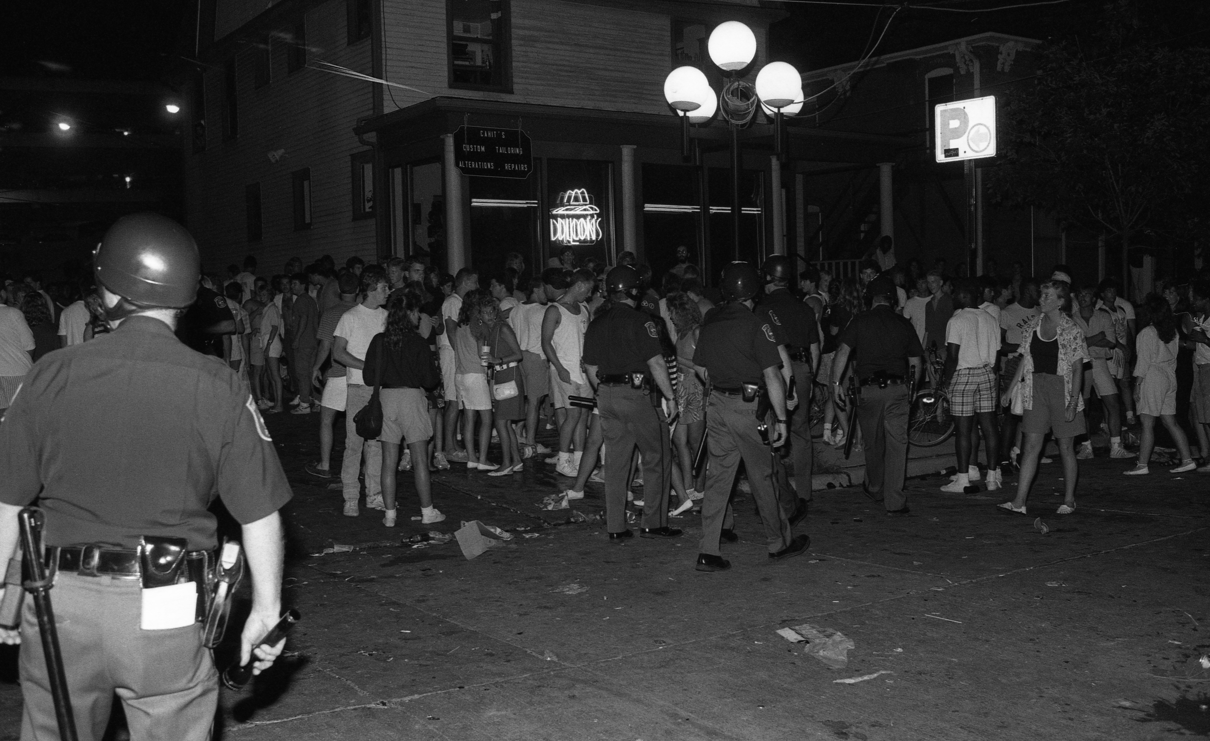 Party People Outside Dillon's Hair Designs on Church Street After Art Fair, July 1987 image