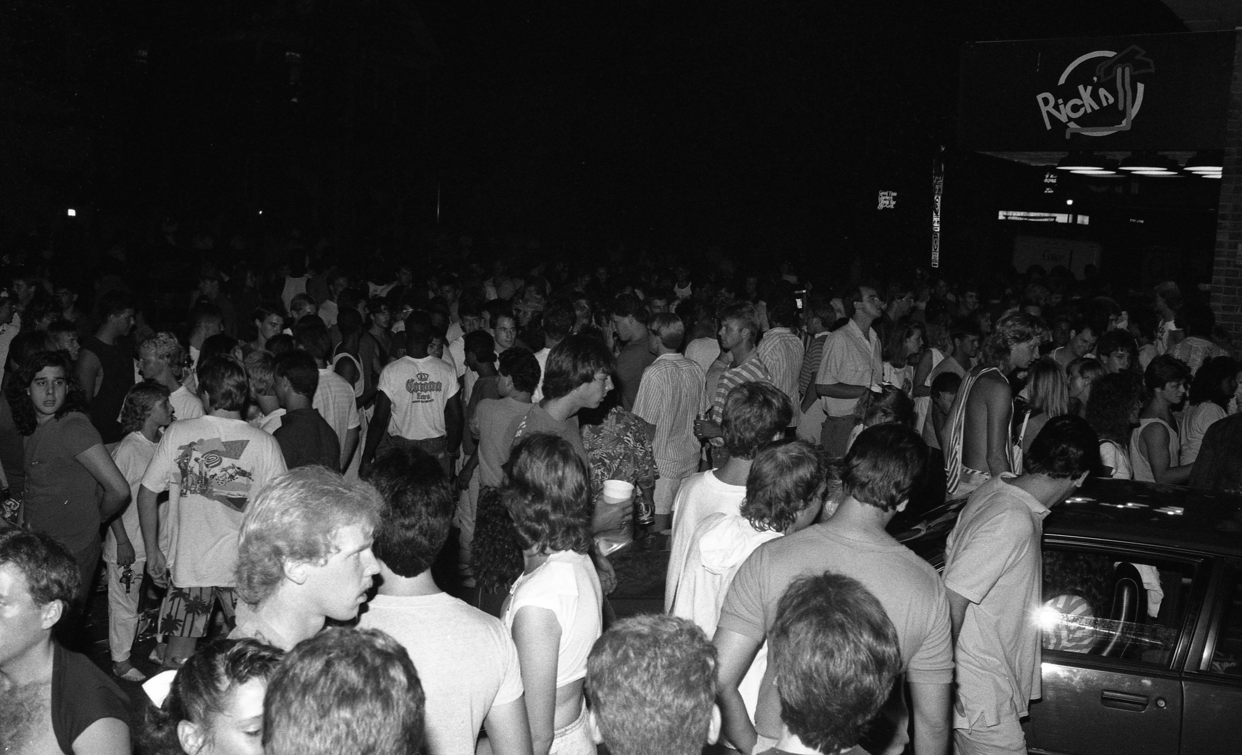 Party People Outside Rick's American Cafe on Church Street After Art Fair, July 1987 image