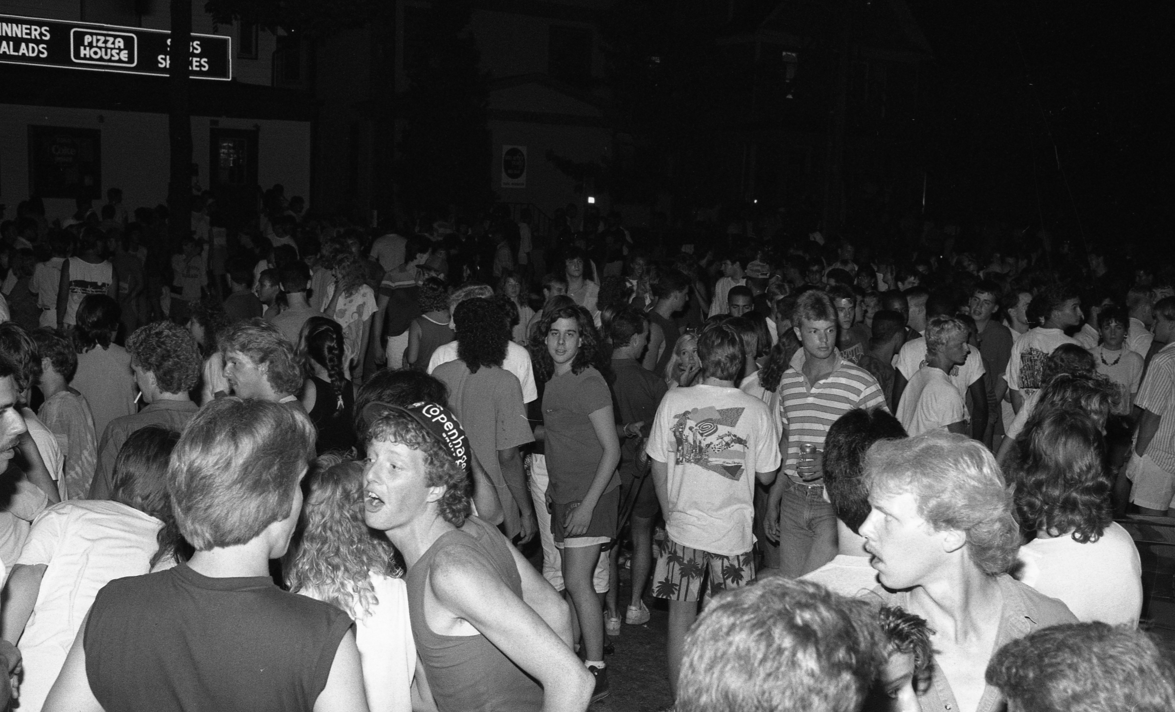 Ann Arbor Police Department Monitors Crowd on South University After Art Fair, July 1987 image
