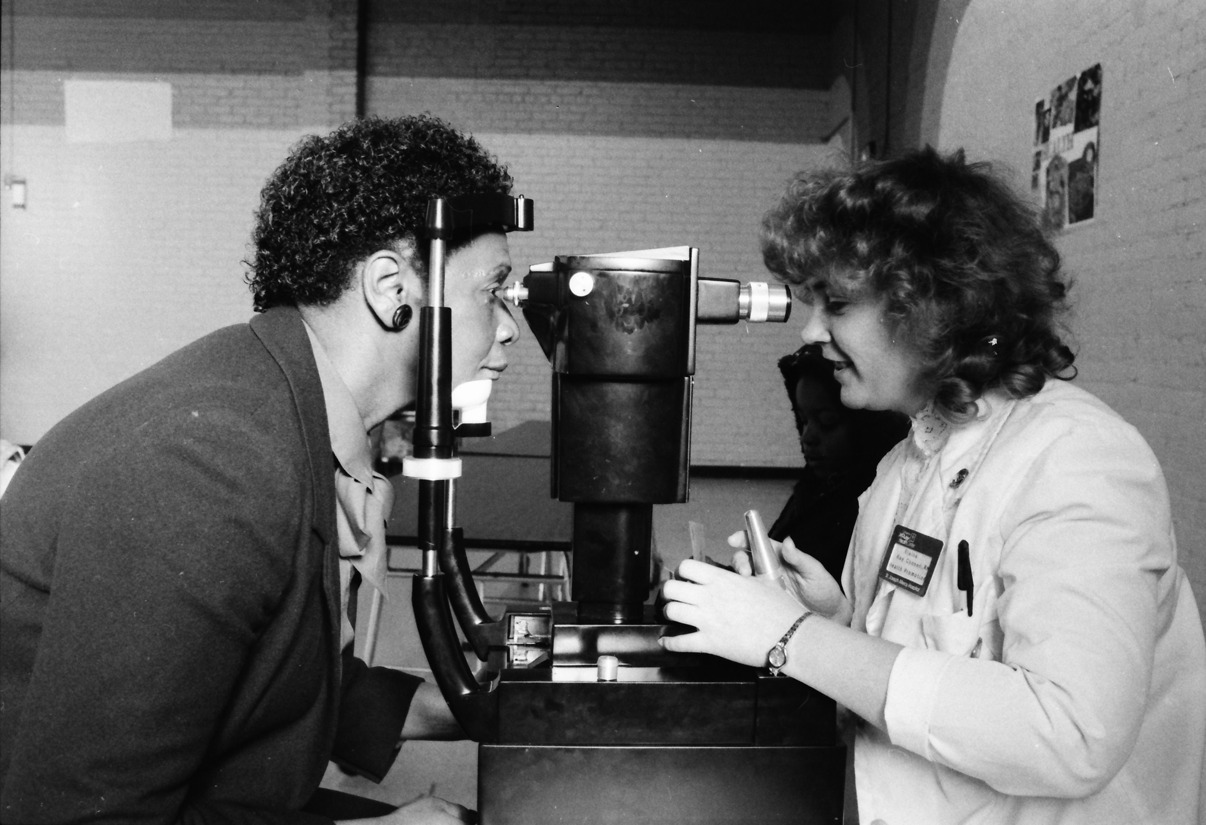 Elsie Tipton Receives Eye Examination at Parkridge Community Center Info Fair, February 1986 image