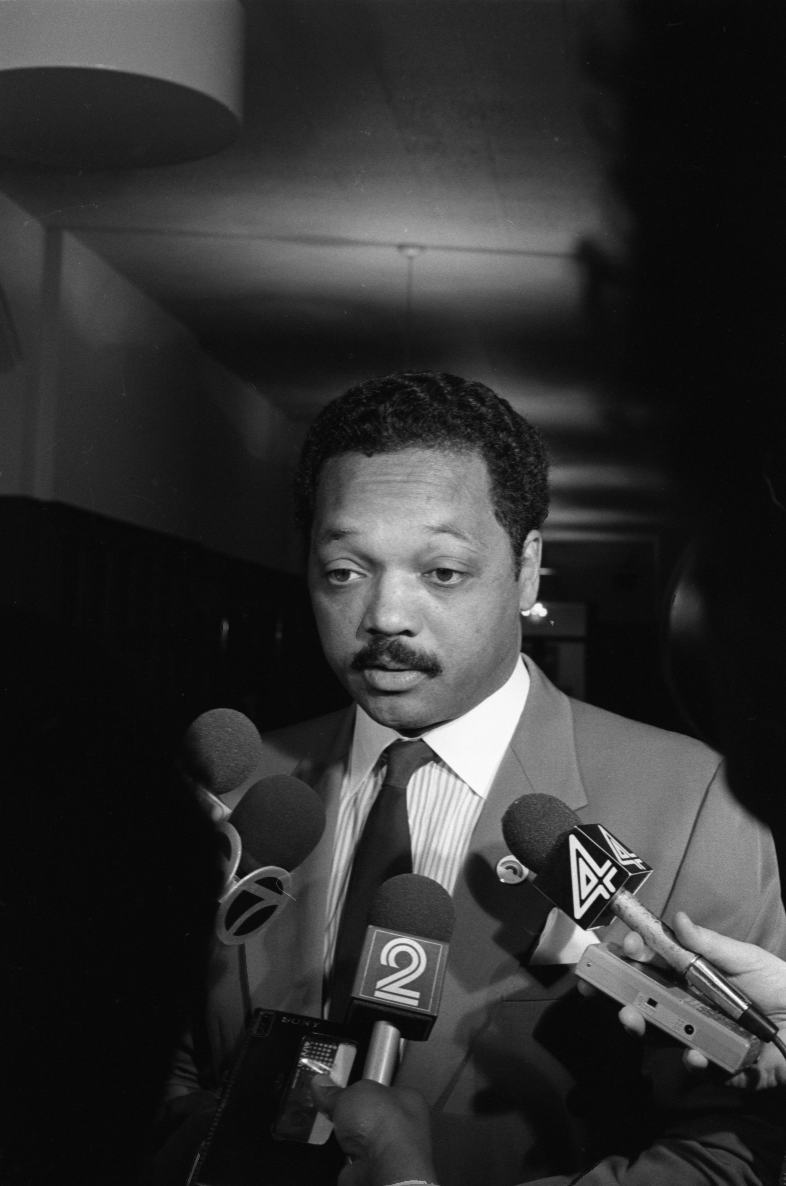 Rev. Jesse Jackson In Ann Arbor For Meeting With Black Action Movement Members Is Interviewed By Reporters, March 23, 1987 image
