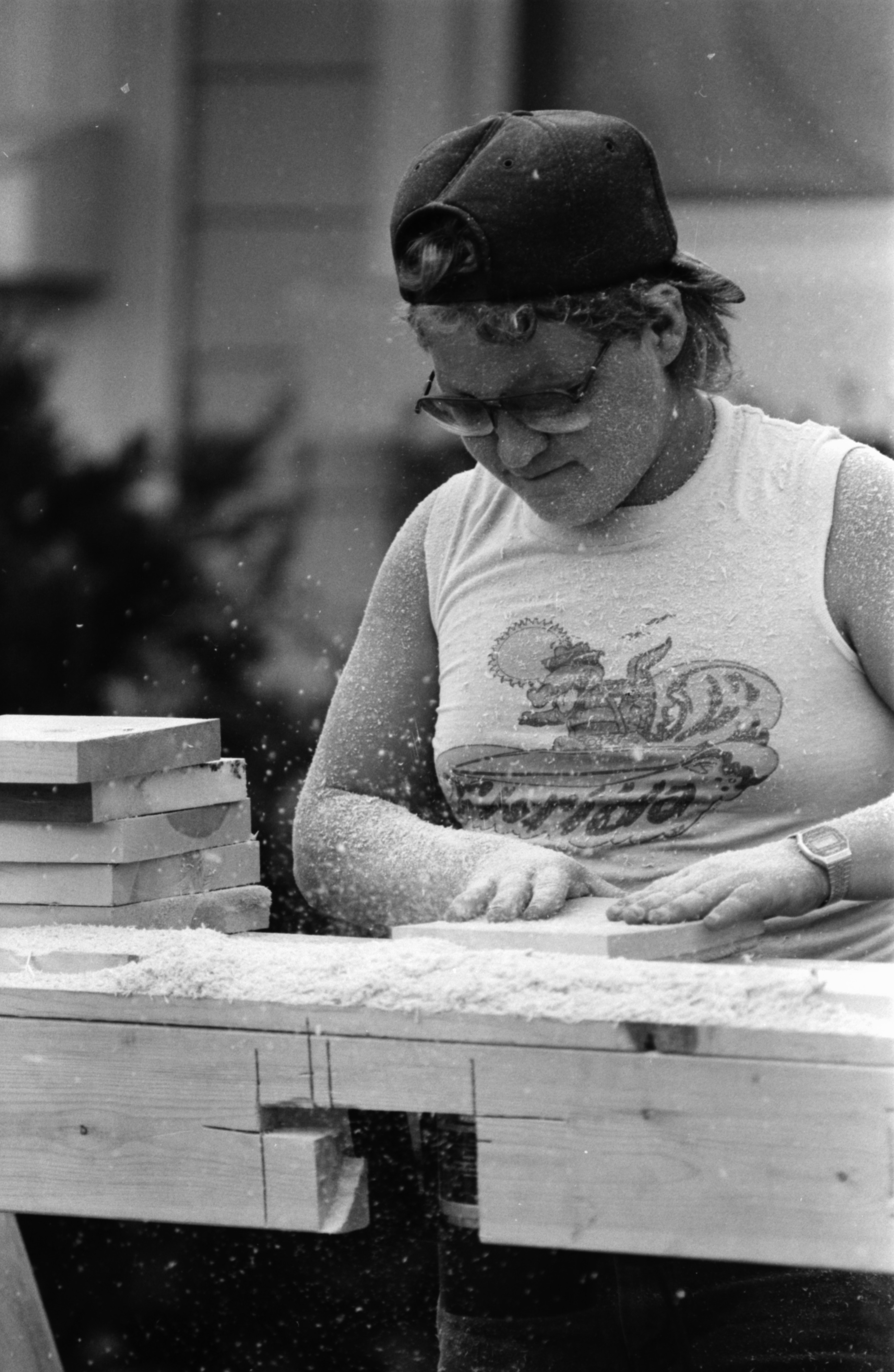 Ted Sanders from Delusha Construction Co. Works on Cutting Wood for Porches at Pittsfield Village, August 1987 image