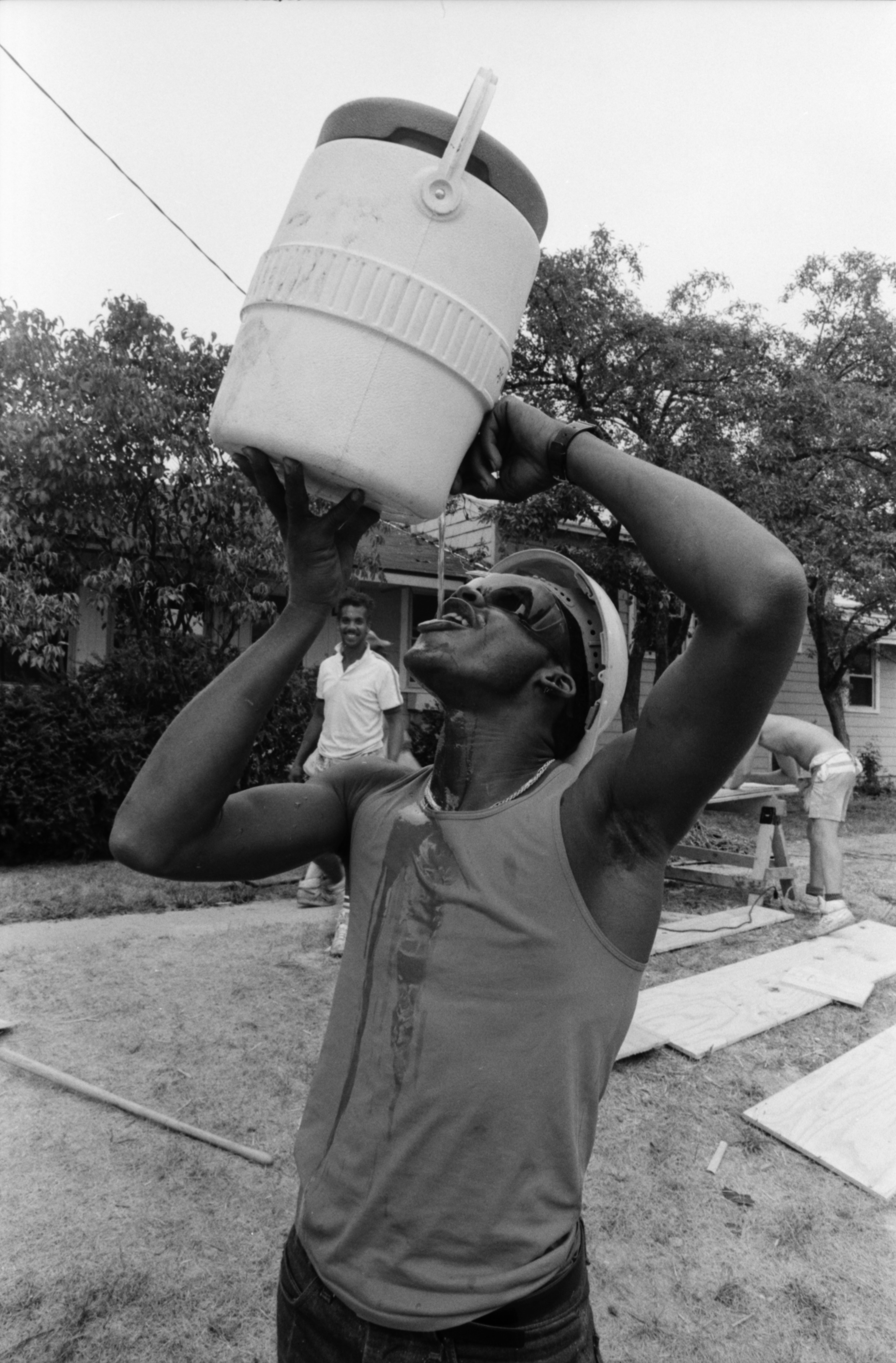 Niles Johnson Takes a Water Break While Working on Construction Pittsfield Village, August 1987 image