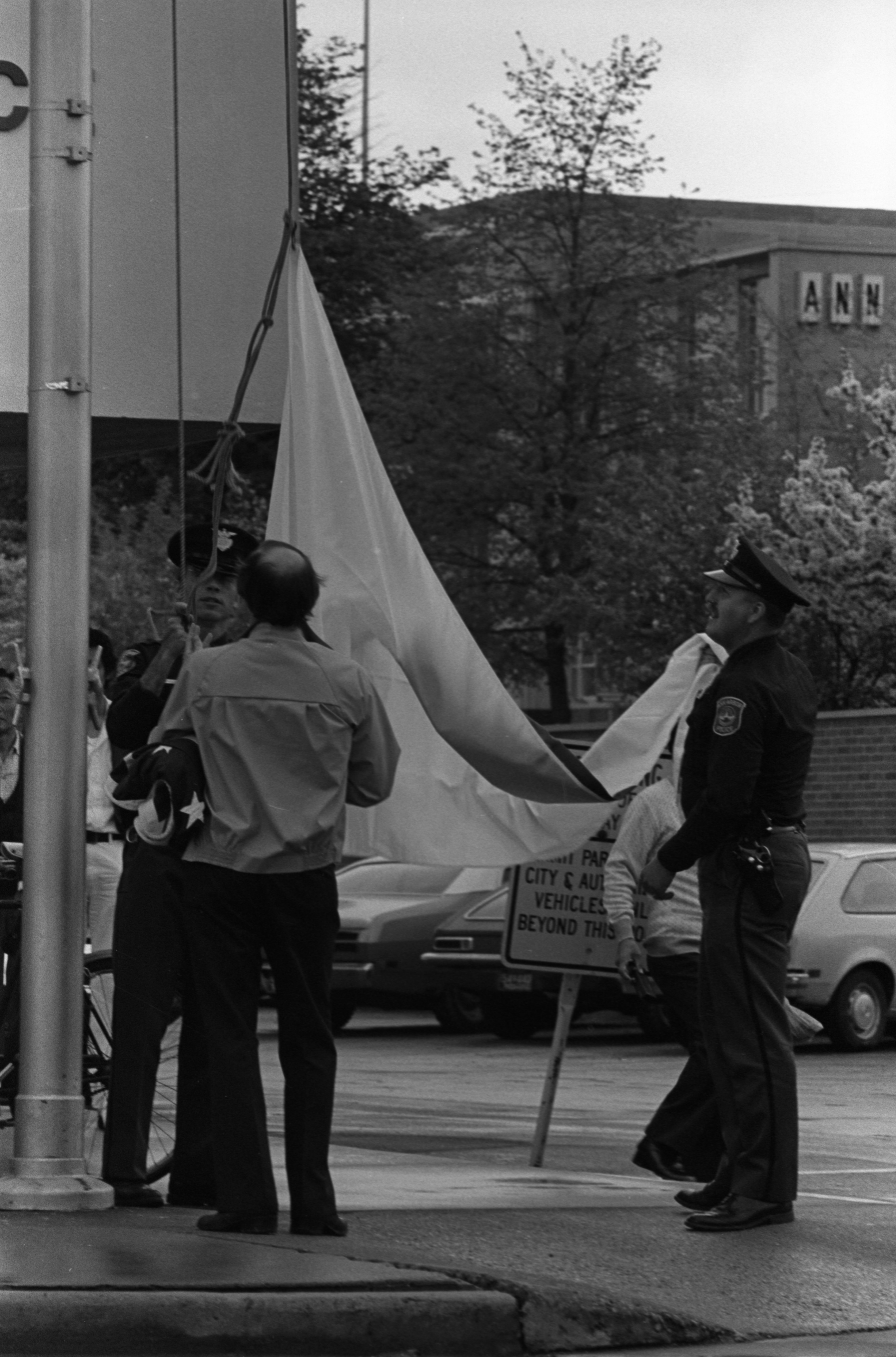 Ann Arbor Police Get Ready To Raise Japanese Flag During Ceremony At City Hall, May 1979 image