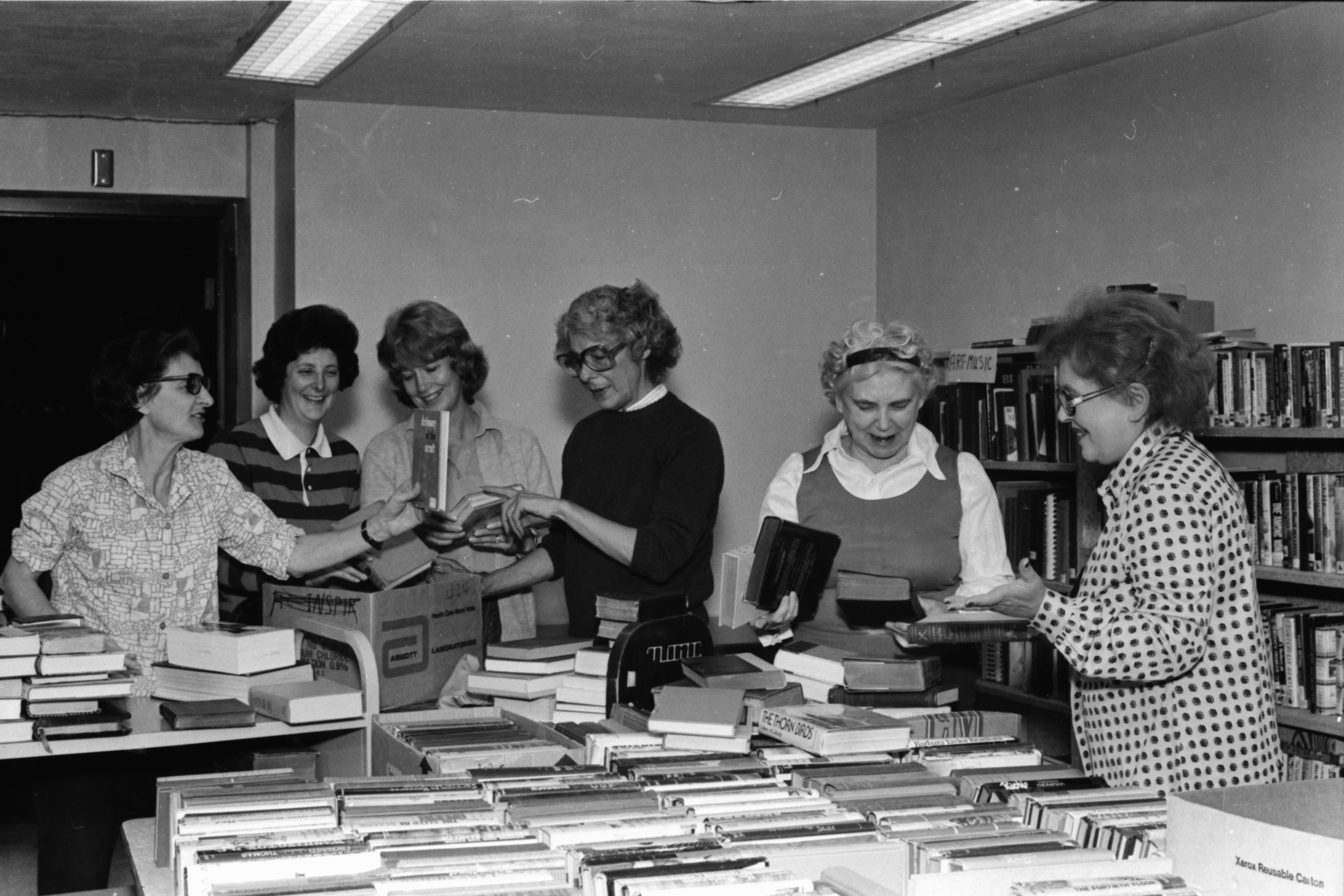 Getting ready for the book sale, November 1979 image