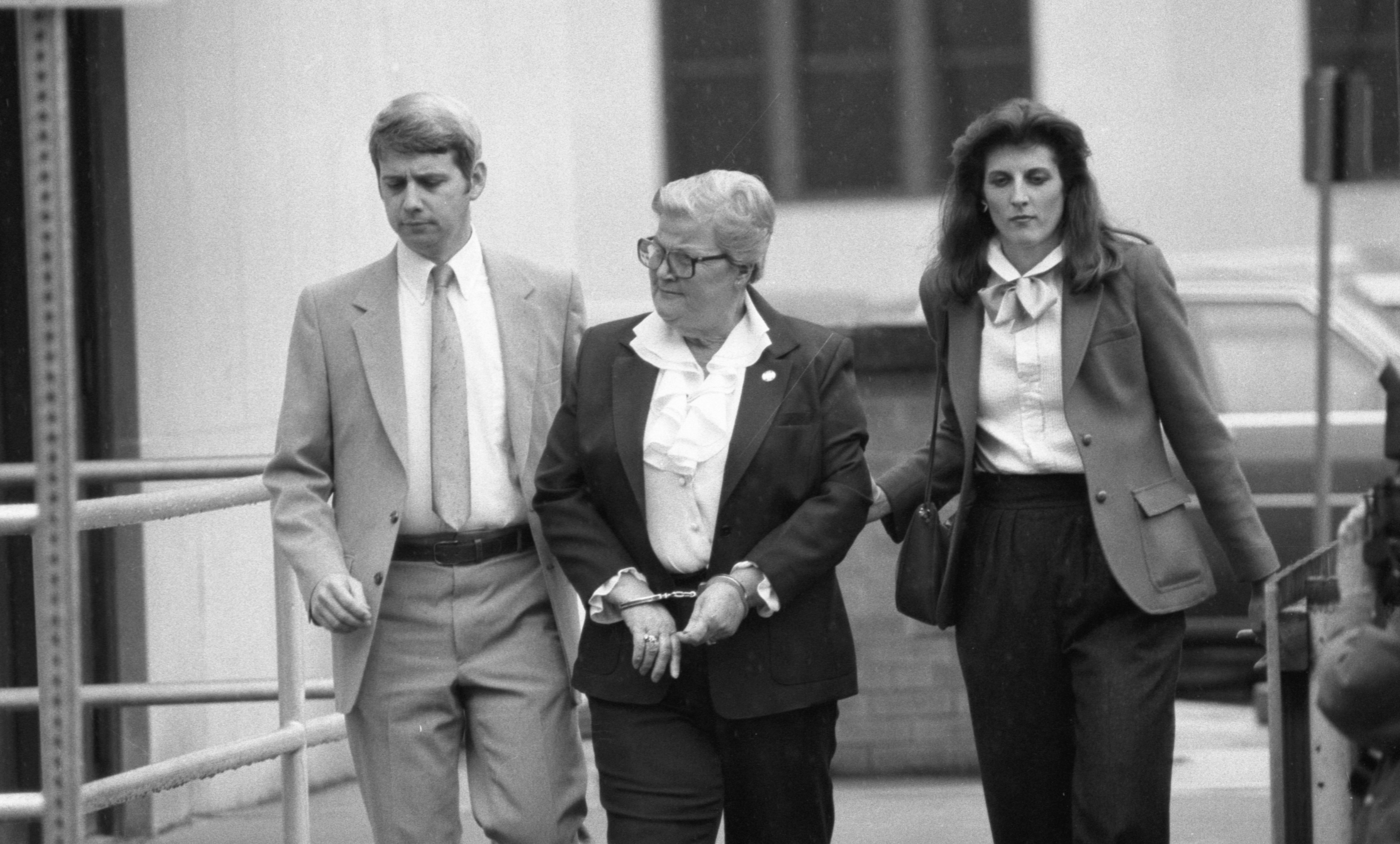 FBI Agents Lead Margaretha Kozminski Away From Washtenaw County Courthouse, November 1983 image