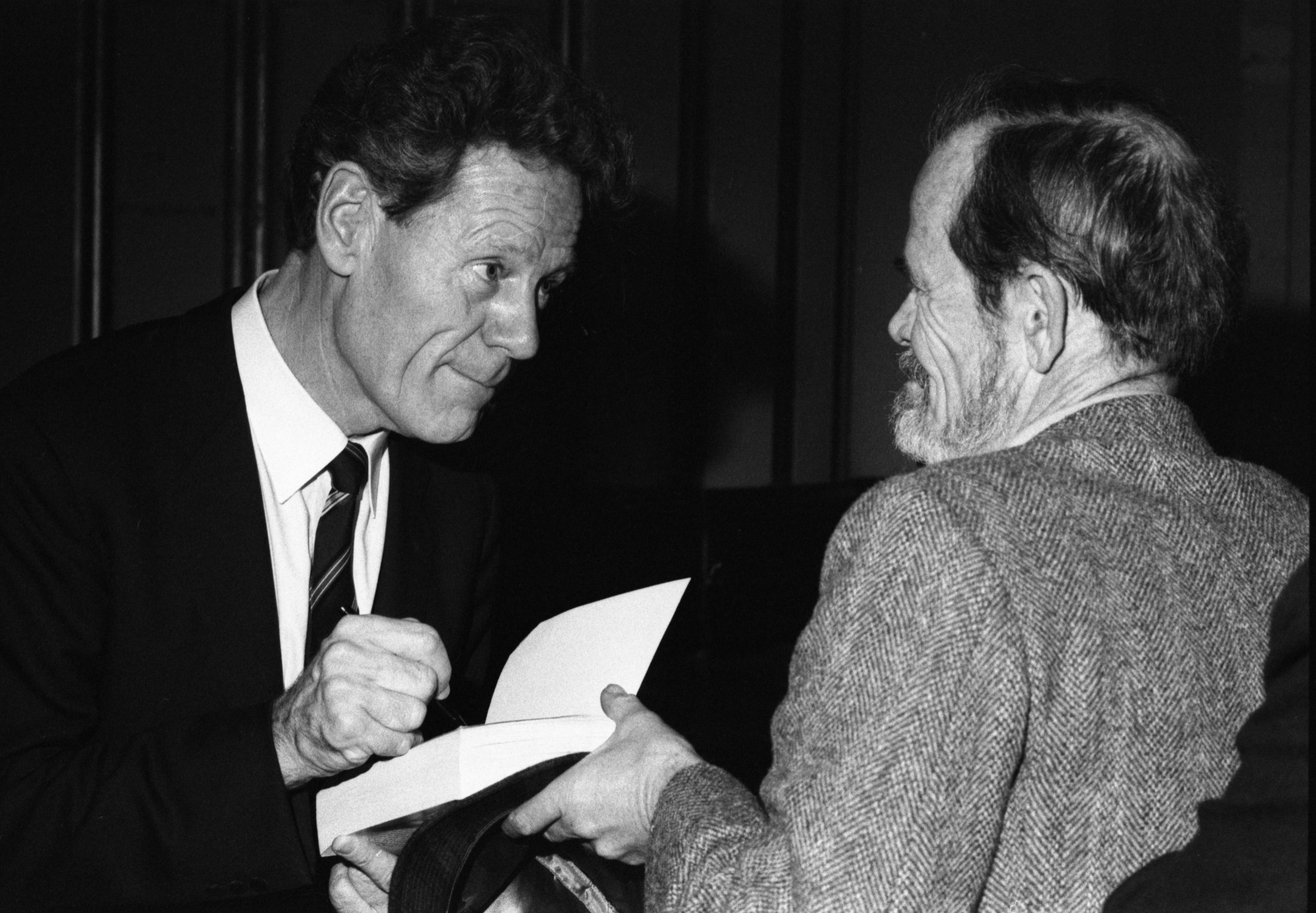 Hans Kung Autographs Book For Fan After Rackham Lecture, November 22, 1983