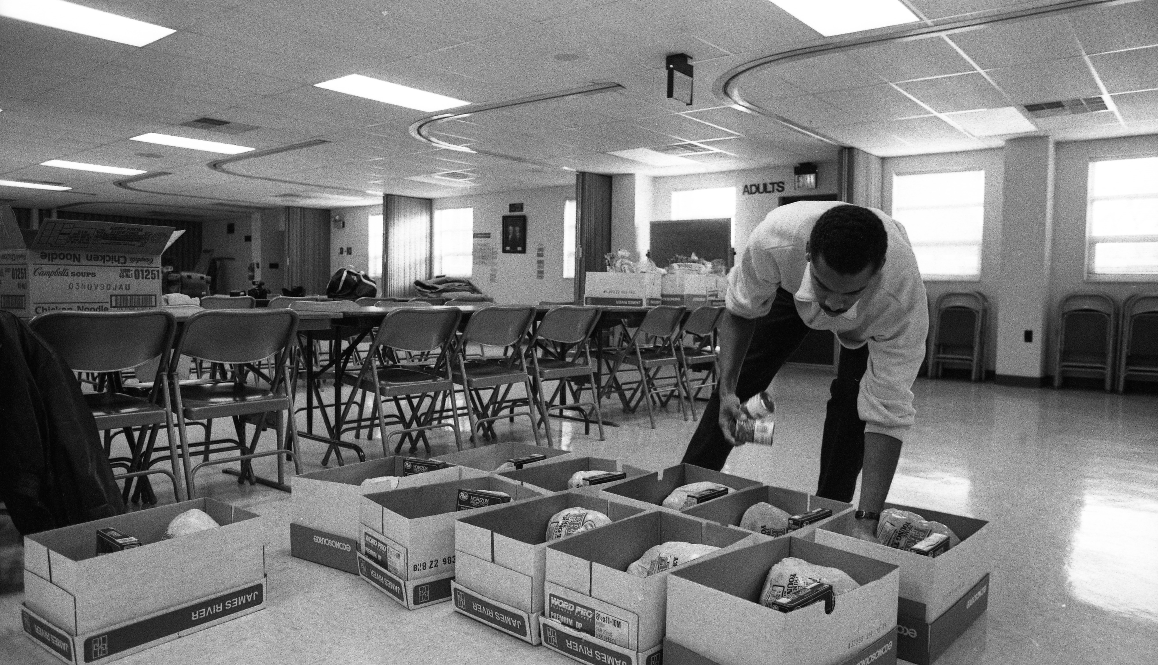 Alpha Phi Alpha Stacking Christmas Food Baskets for the Needy at Second Baptist Church, December 1988 image