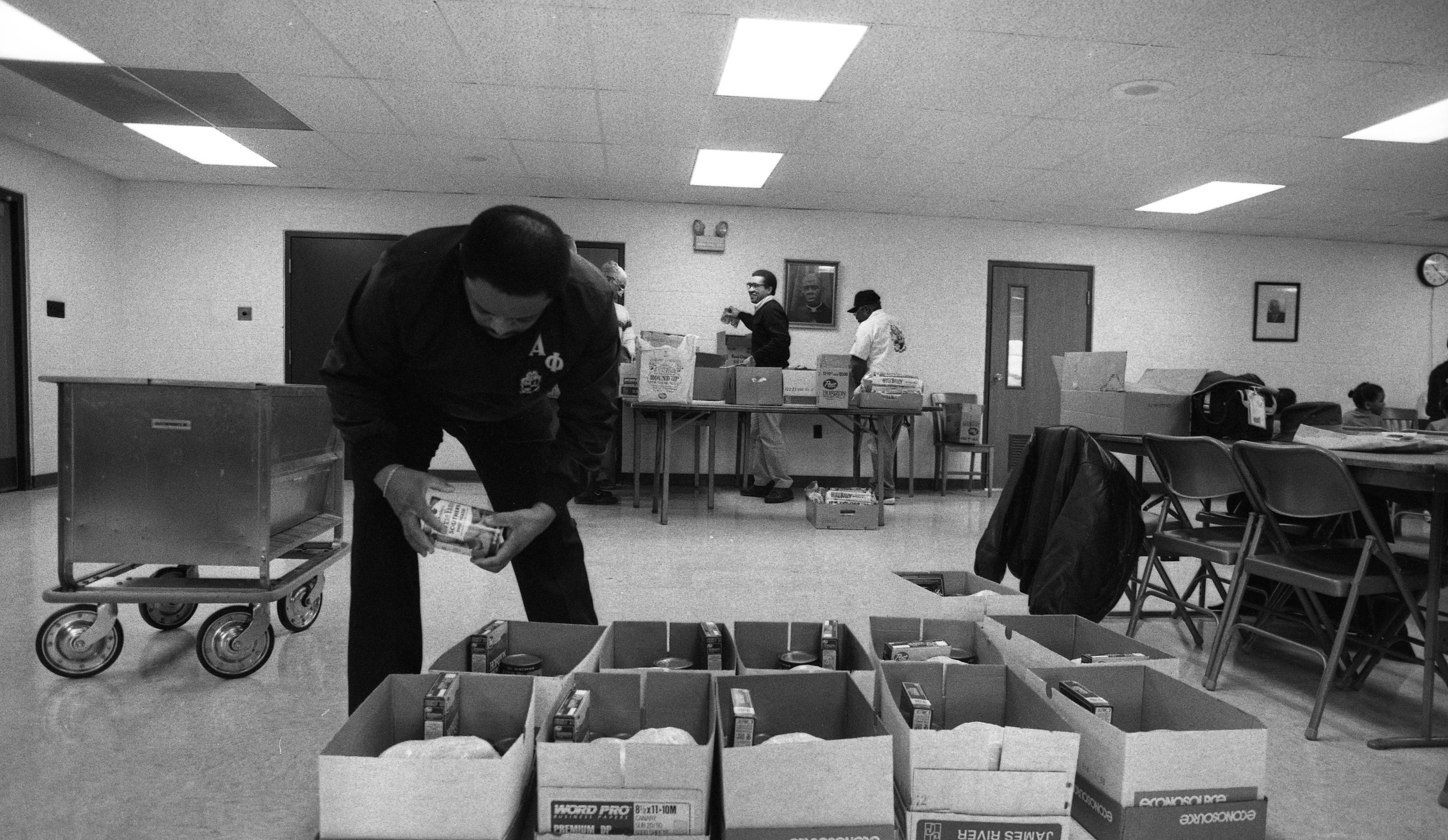 Alpha Phi Alpha Checks the Christmas Food Baskets for the Needy at Second Baptist Church, December 1988 image