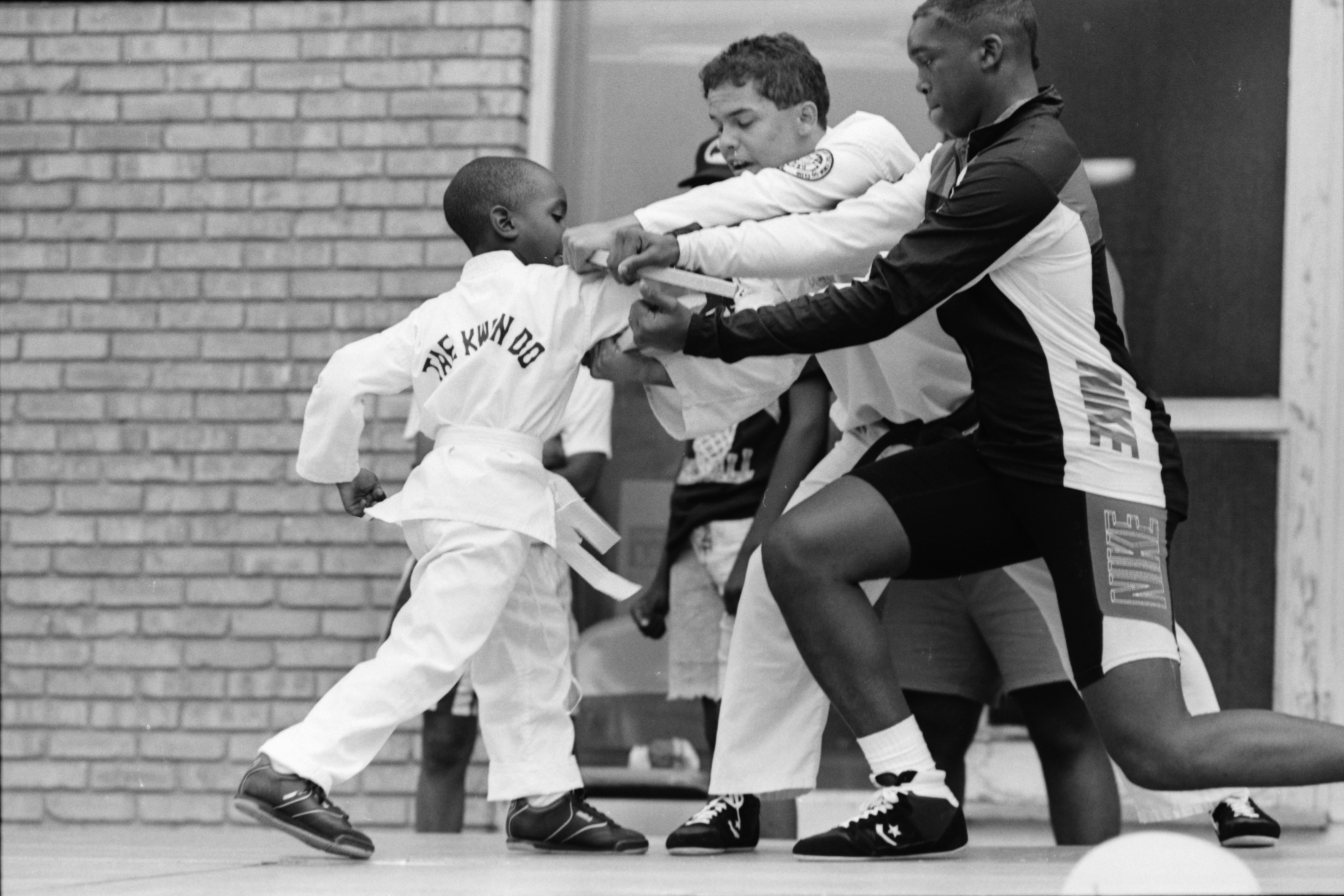 Johnny Smith Demonstrates Tae Kwon Do Board Breaking Technique at Summer Camp Party, August 1989 image