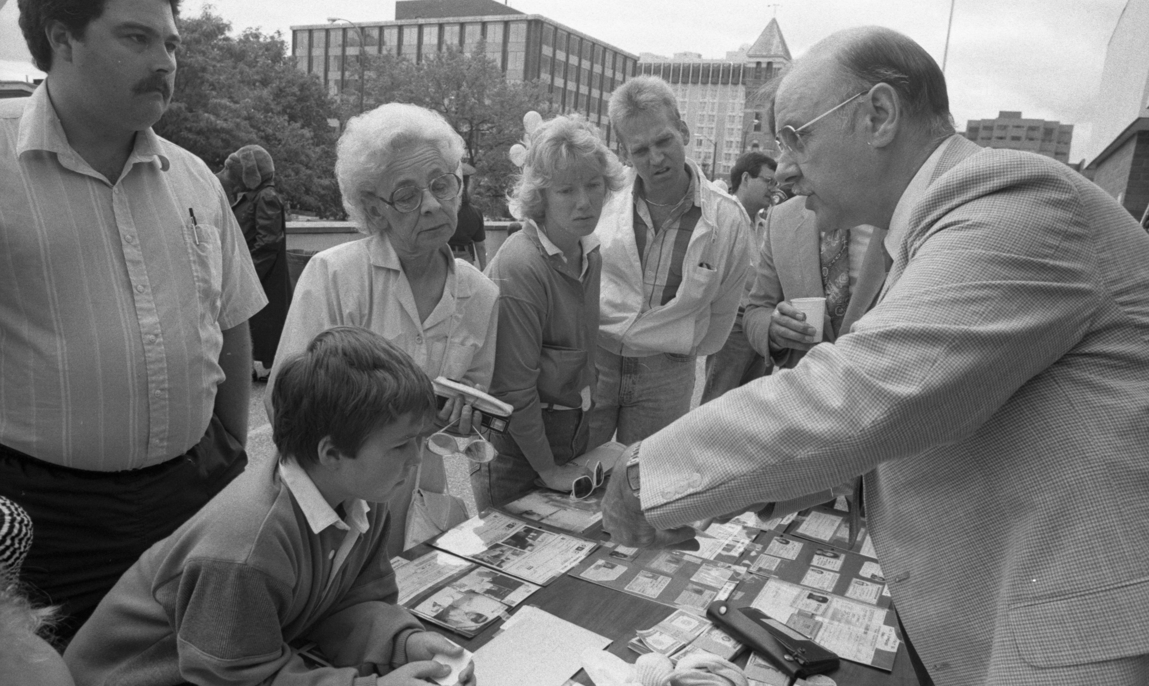 Detective Exhibits Counterfeiting Evidence at Ann Arbor Police Department Open House, September 1989 image