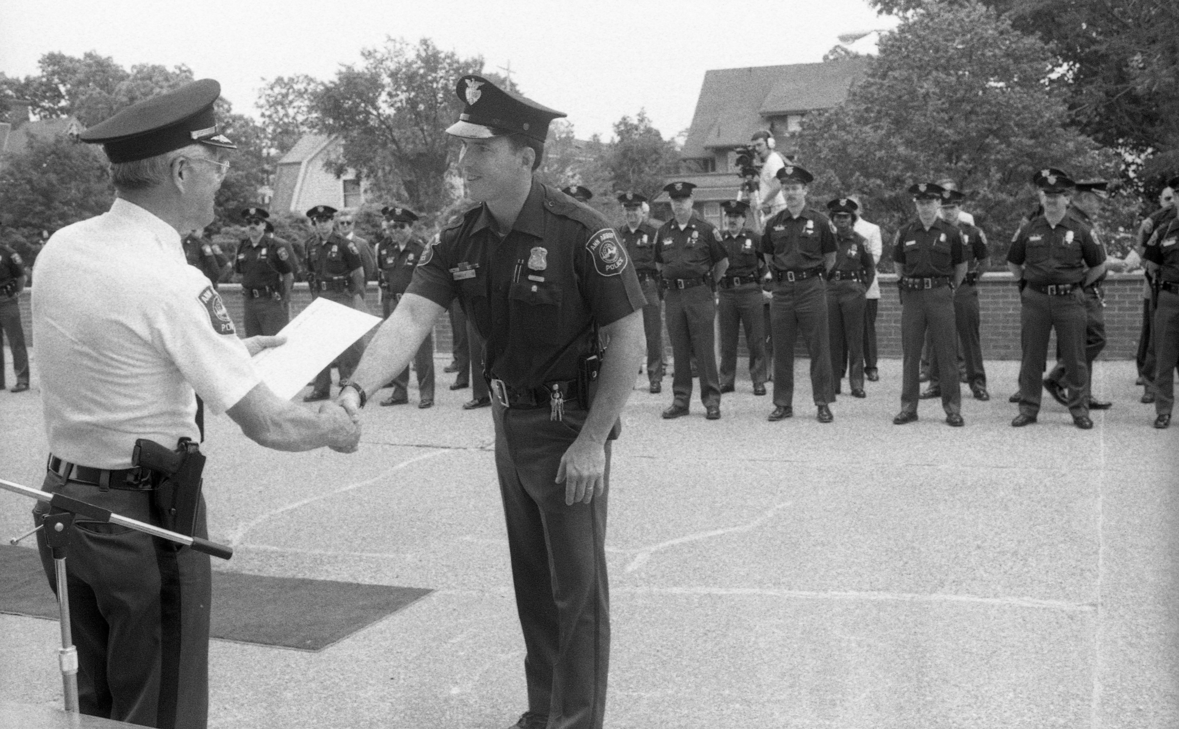 Handshake at the Ann Arbor Police Department Community Service Awards Ceremony, June 1990 image