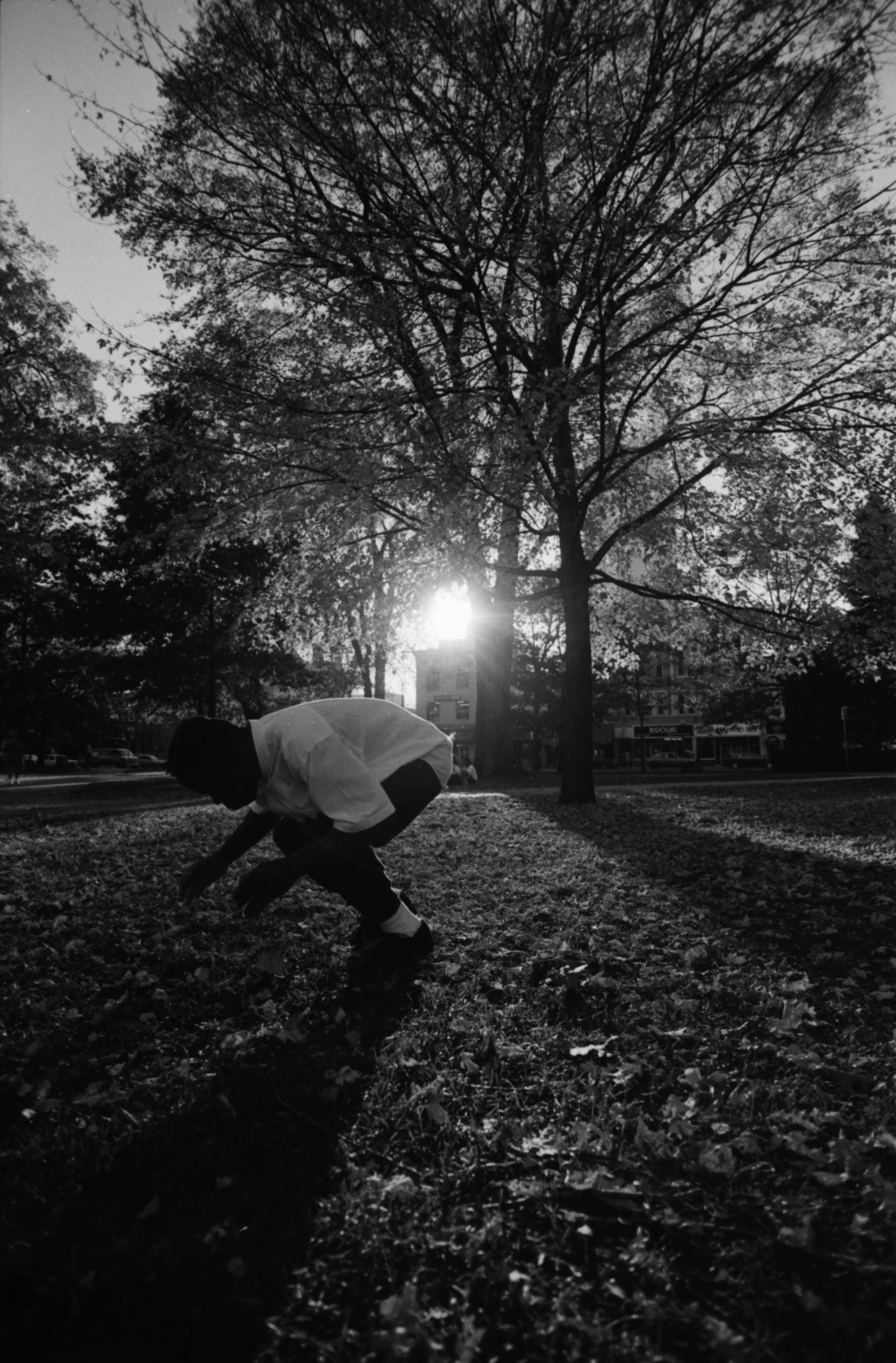 Pioneer High School student Lance Johnson does a back flip on the Diag, October 1989 image