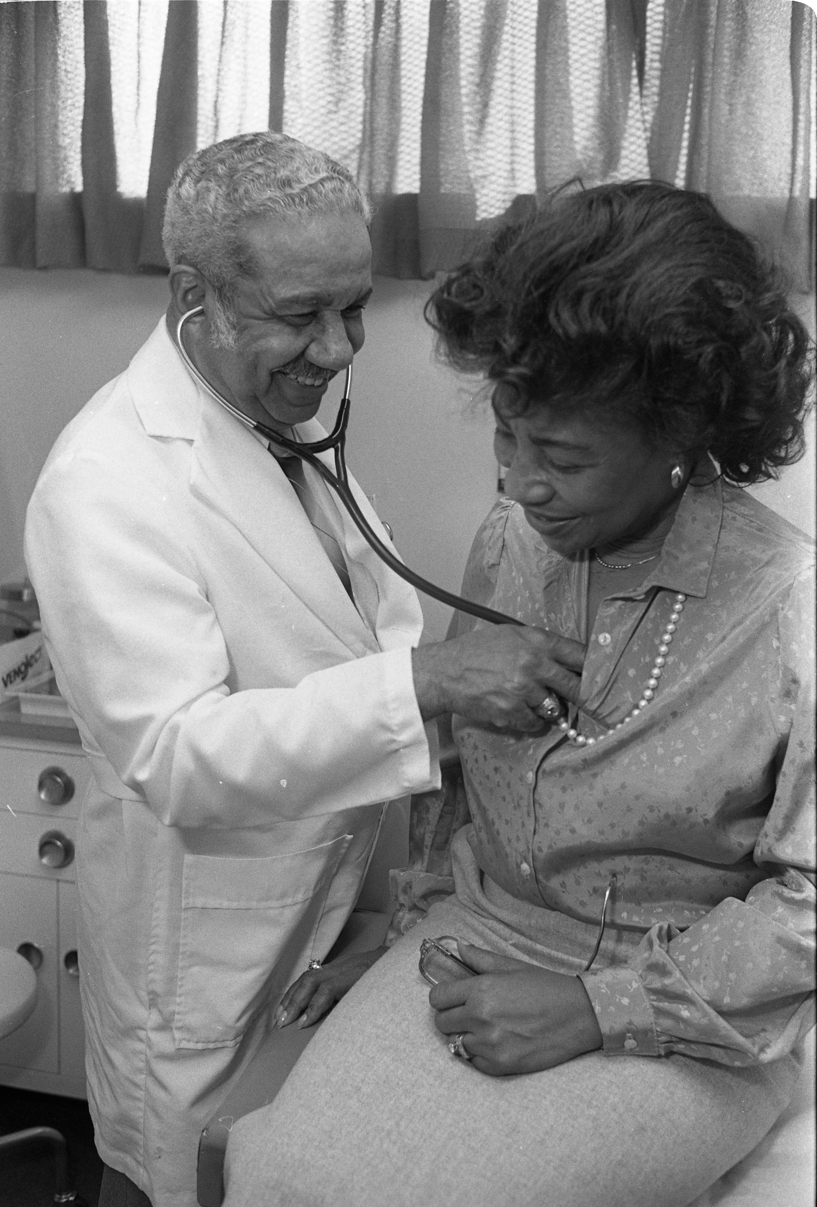Dr. John C. Shelton With Patient, February 24, 1990 image