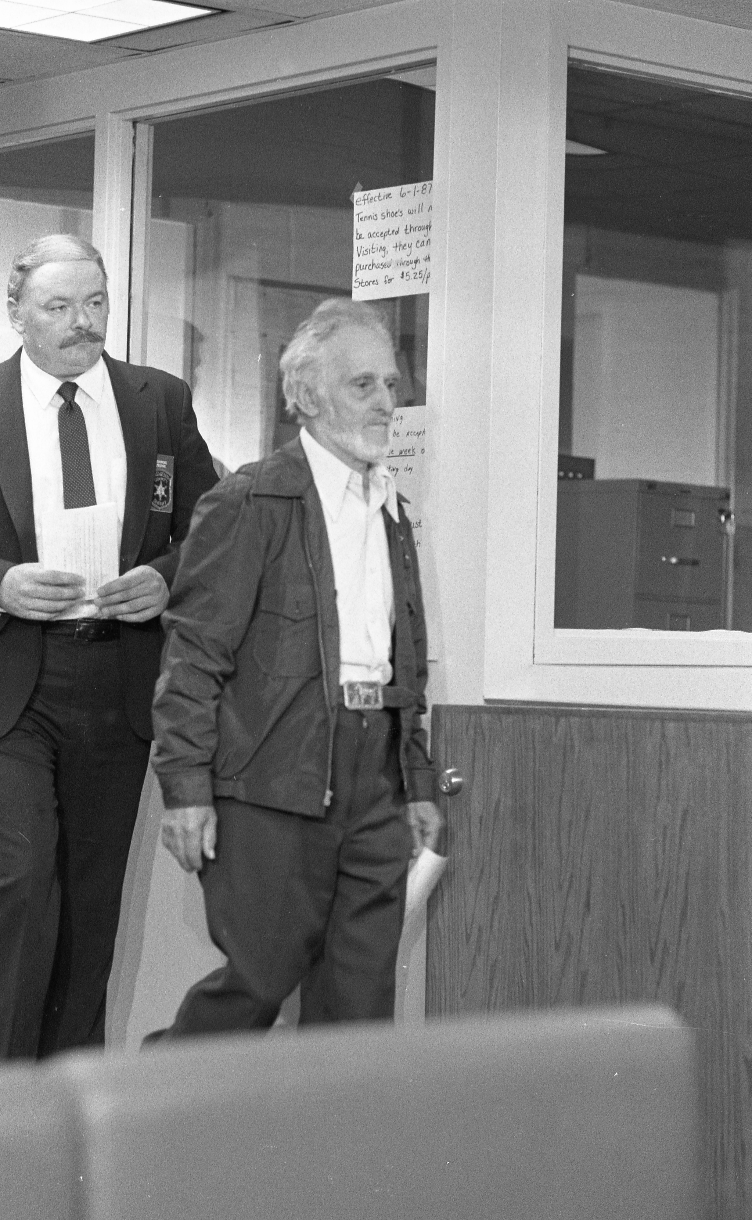 Wilford P. Cashman, aka John E. Burns, Is Followed By Detective William Eskridge At Washtenaw County Jail, June 1987 image