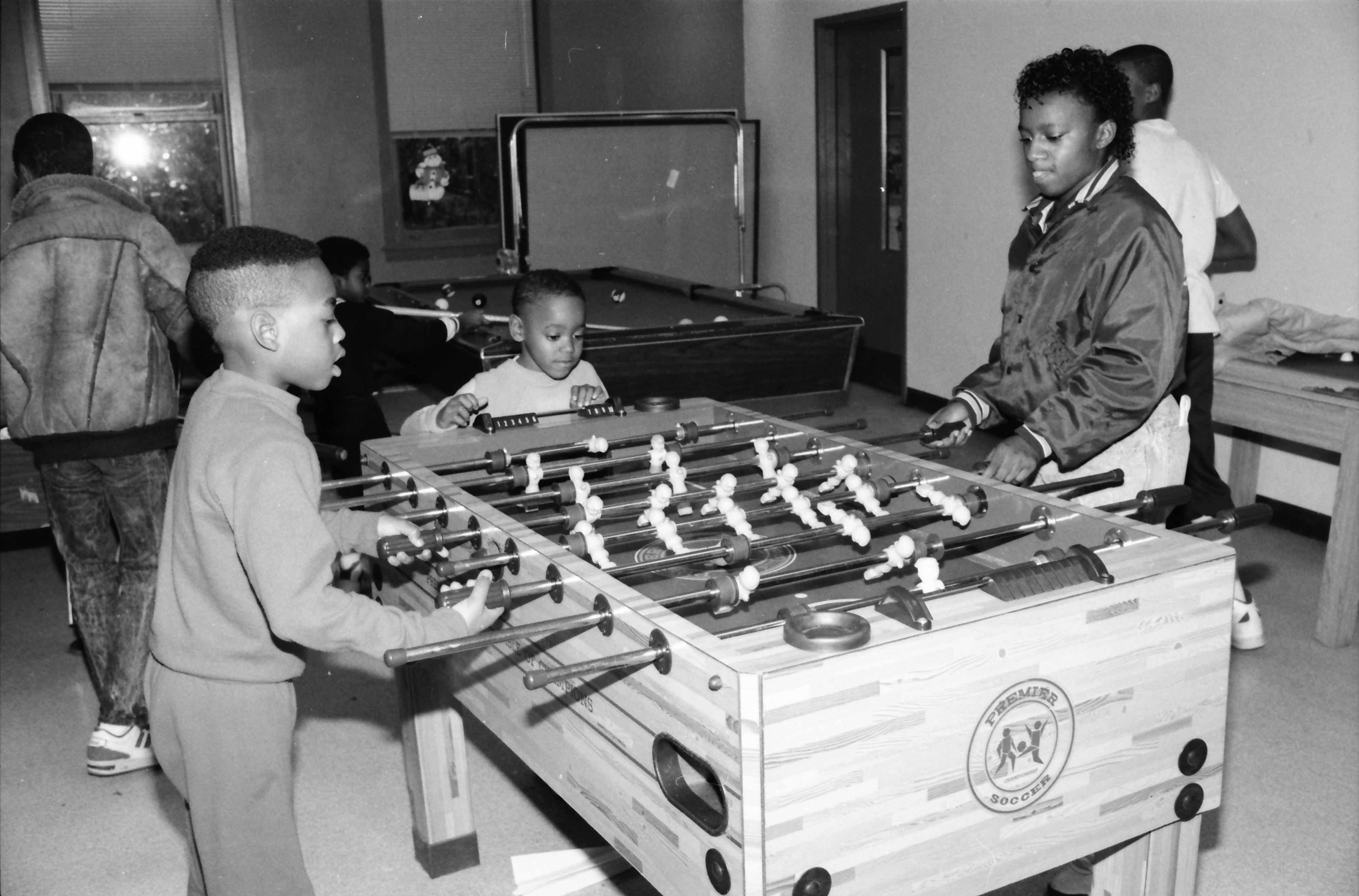 Children Playing Foosball at Parkridge Community Center, December 1988 image