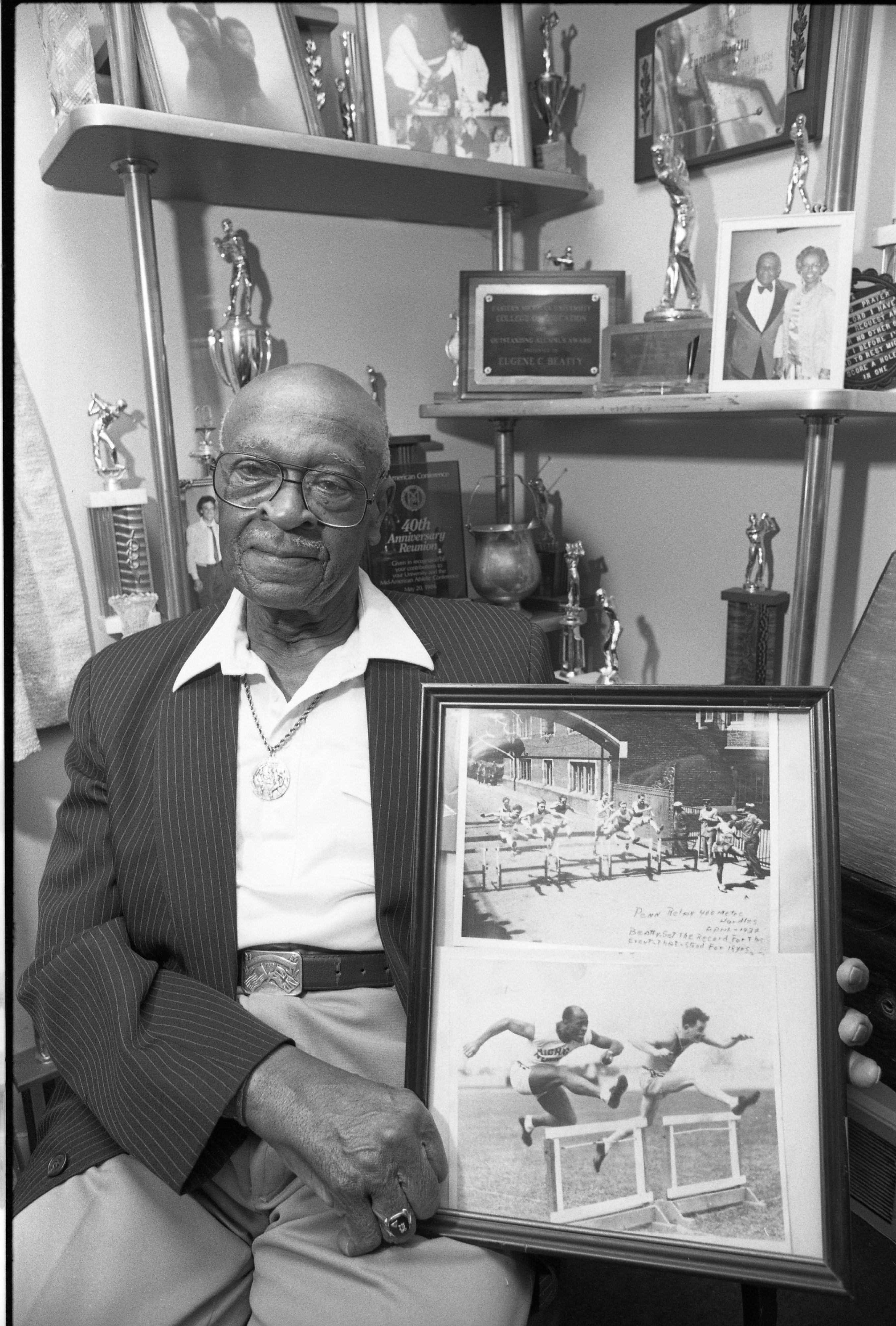 Eugene Beatty Showing Photos Of Himself Winning The 1932 Penn Relays, March 8, 1991 image