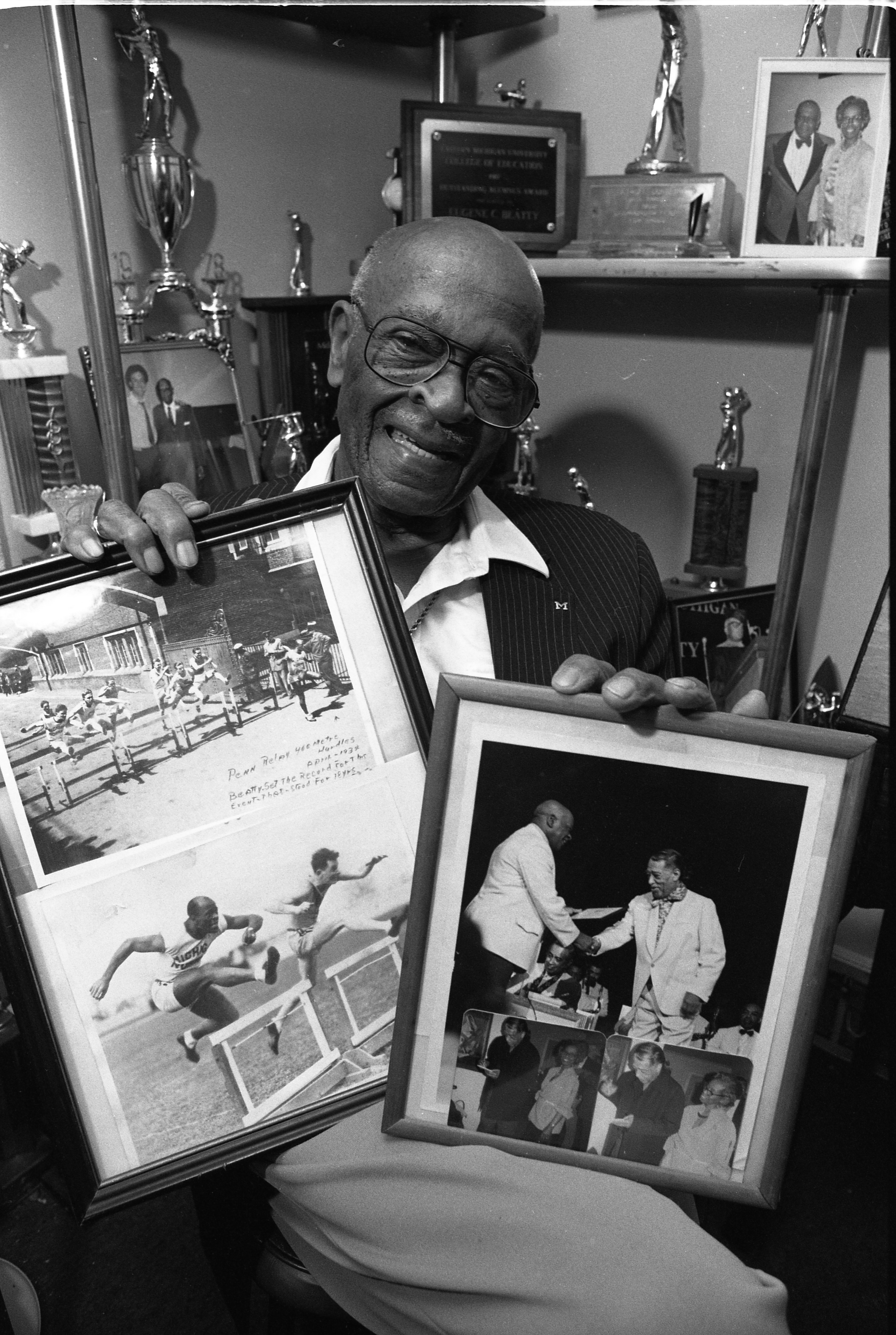 Eugene Beatty Showing Photos Of Himself In The Penn Relays & Meeting Duke Ellington, March 8, 1991 image